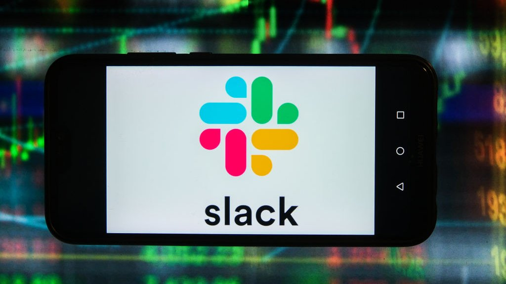 In this photo illustration a Slack logo is displayed on a