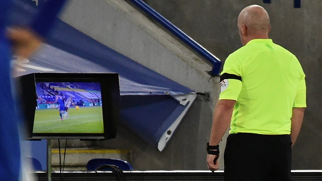 epa08853526 English referee Simon Hooper checks the VAR screen during the English Premier League soccer match between Leicester City and Fulham FC in Leicester, Britain, 30 November 2020.  EPA/Rui Vieira / POOL EDITORIAL USE ONLY. No use with unauthorized audio, video, data, fixture lists, club/league logos or 'live' services. Online in-match use limited to 120 images, no video emulation. No use in betting, games or single club/league/player publications.