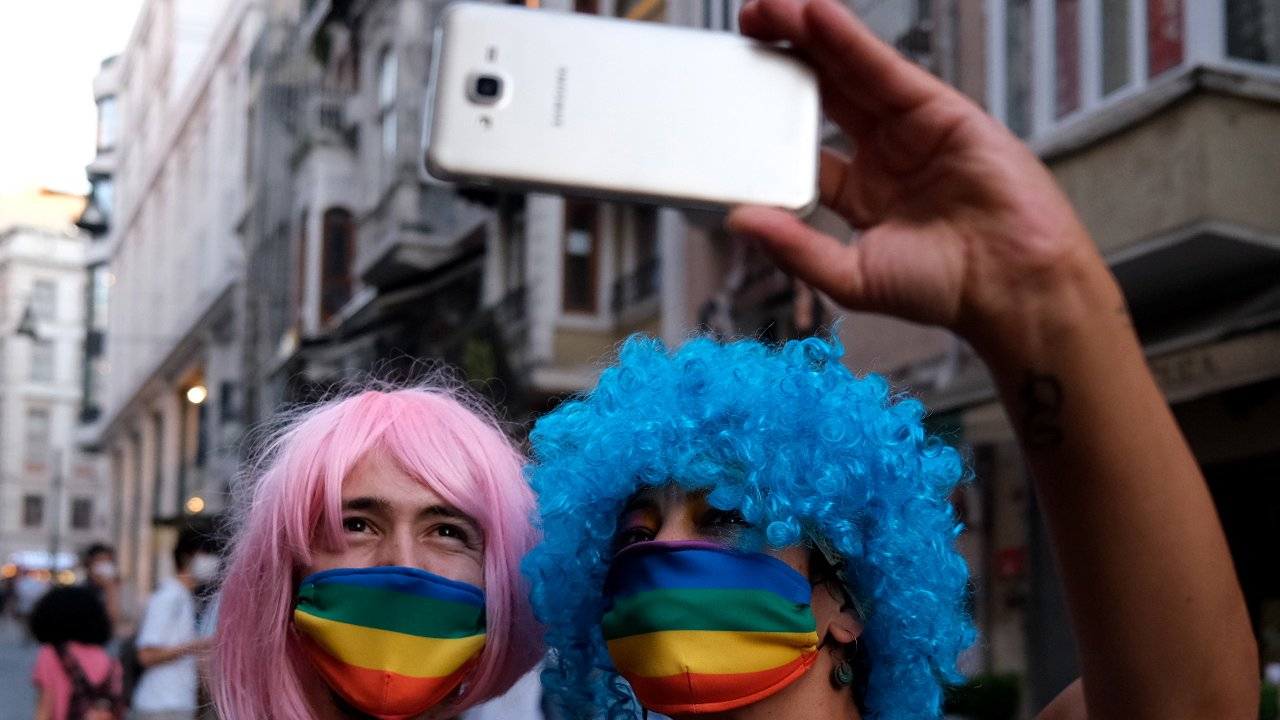 epa08514972 LGBTI (lesbian, gay, bisexual, transgender, and intersex) community members and supporters wear rainbow mask as they take selfie during the Global Pride in Istanbul, Turkey, 28 June 2020.  EPA/SEDAT SUNA