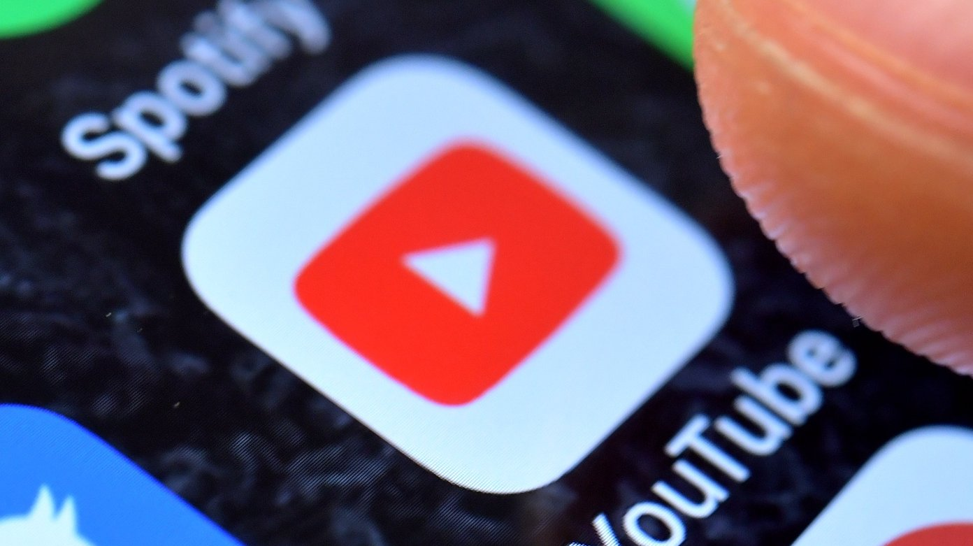 epa08934619 (FILE) - A close-up image shows the YouTube app on an iPhone in Kaarst, Germany, 08 November 2017 (reissued 13 January 2021). YouTube announced on 12 January 2021 that it temporarily suspended US President Donald J. Trump's account for a minimum of seven days citing concerns about the potential of violence following riots at the US Capitol in Washington, DC, USA last week. The Google-owned video-sharing service follows other social media and online services limiting the president's online activities. The suspension temporarily prevents Trump's channel from uploading new videos or live-streaming material, even though the channel continues to be live.  EPA/SASCHA STEINBACH *** Local Caption *** 53883779