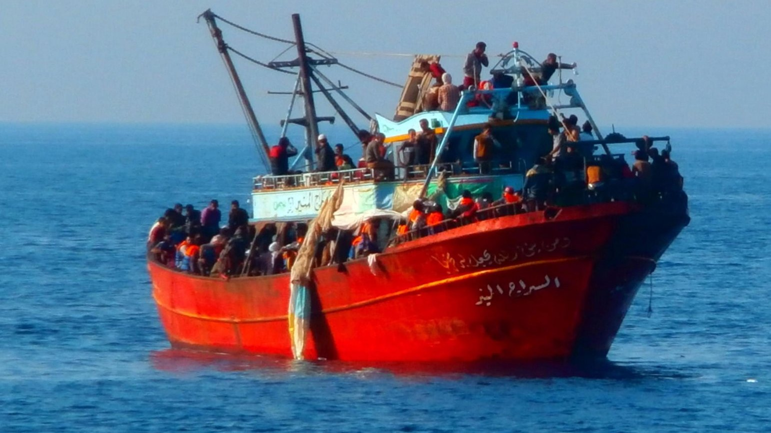 epa04255734 A handout picture released by the Italian Coast Guard shows a boat carrying 281 refugees, at sea off the coast of Calabria Region, Italy, 14 June 2014.  Nearly 300 migrants who said they were refugees from Syria have been rescued off the Italian coast, officials. The coast guard said two patrol boats and a a tax police vessel picked up 281 people from a 20-metre fishing boat some 150 kilometres away from the coast of Calabria, the region that forms the tip of Italy's boot. The migrants were spotted in the Mediterranean between Greece and Italy. Among the rescued passengers were 93 children and six women, some of who were in a precarious medical condition, the coast guard said.  EPA/ITALIAN COASTGUARD / HANDOUT  HANDOUT EDITORIAL USE ONLY/NO SALES/NO ARCHIVES