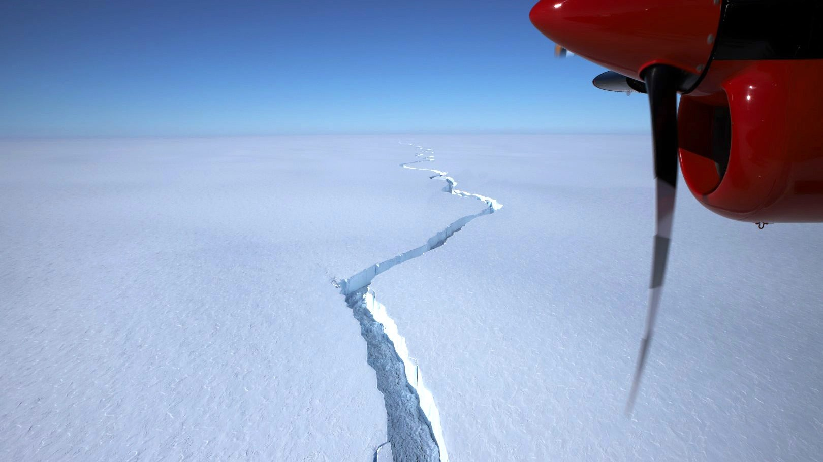 epa09044808 A handout photo made available by the British Antarctic Survey (BAS) shows a crack in the Brunt Ice Shelf during flyover on 12 January 2021 (issued 01 March 2021). An iceberg of approximately 1,270 square kilometers split from the Brunt Ice Shelf on 26 February 2021.  EPA/AVANKINTS/BAS / HANDOUT  HANDOUT EDITORIAL USE ONLY/NO SALES