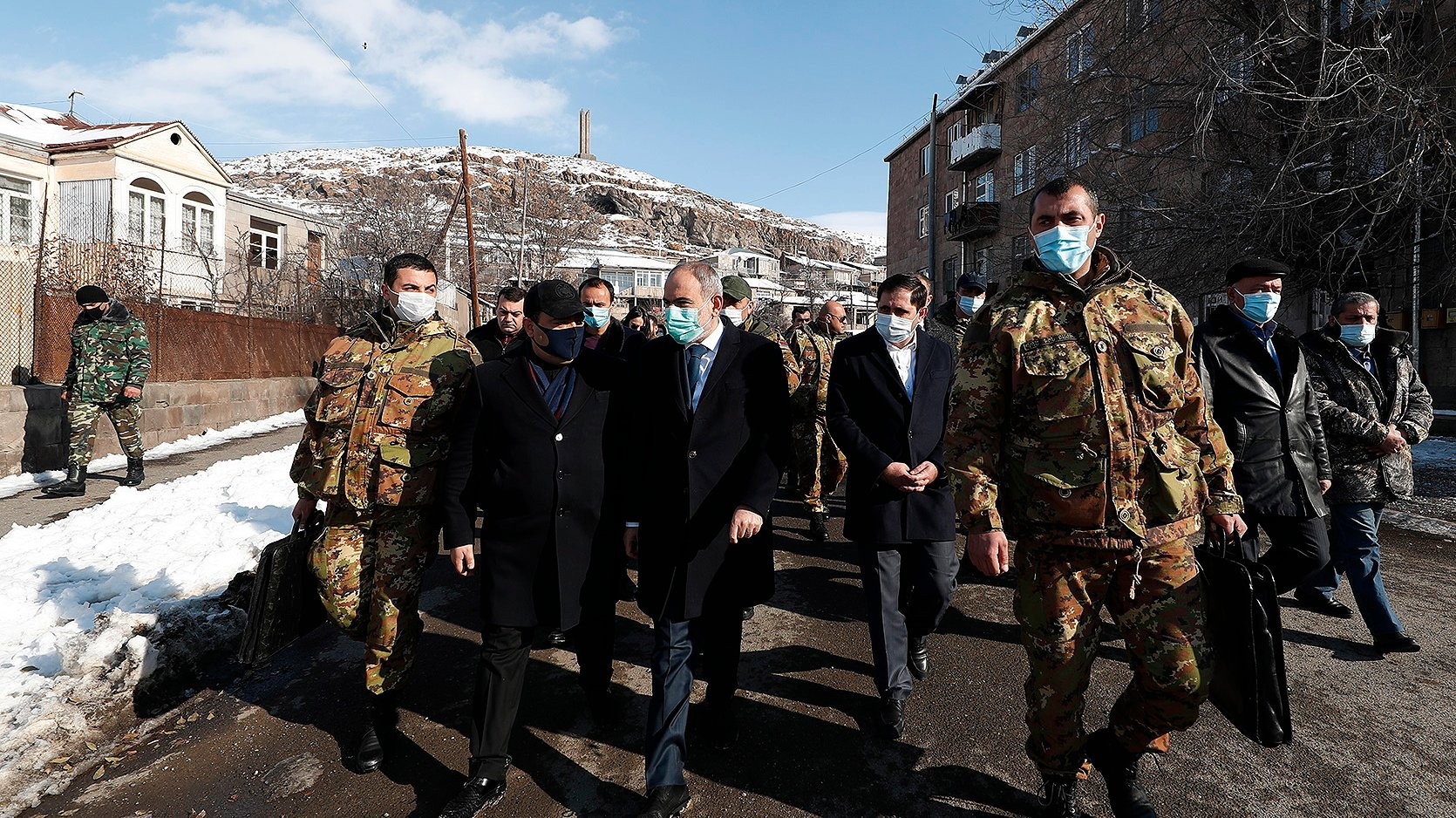 epa08897899 A handout photo made available by the press office of Armenian government shows Armenian Prime Minister Nikol Pashinyan (C) walks on a street in Sisian, Syunik region, Armenia, on the third day of the nationwide mourning 21 December 2020. Armenian Prime Minister Nikol Pashinyan declared a 3-day nationwide mourning period starting on December 19 for people who had been killed in the latest armed conflict between Azerbaijan and Armenia over the Nagorno-Karabakh territory along the contact line of the self-proclaimed Nagorno-Karabakh Republic (also known as Artsakh).  EPA/ARMENIAN GOVERNMENT PRESS OFFICE HANDOUT MANDATORY CREDIT HANDOUT EDITORIAL USE ONLY/NO SALES