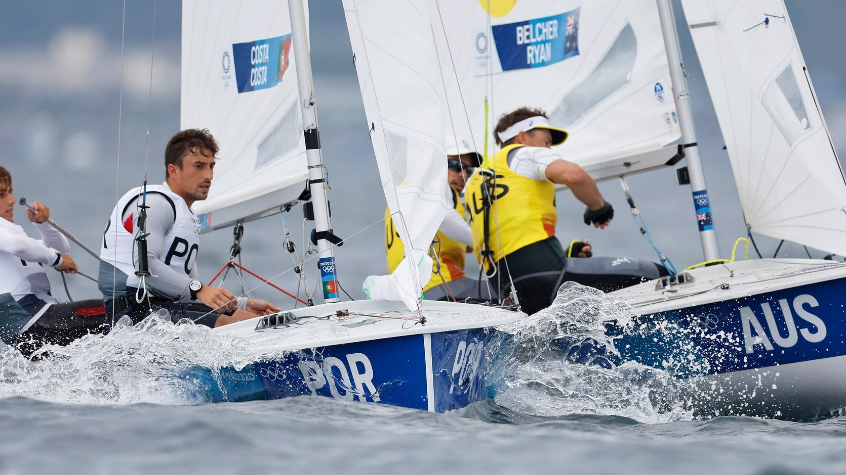 epa09379172 Diogo Costa and Pedro Costa of Portugal (L)  compete with Mathew Belcher and Will Ryan of Australia (R) in the Men's 470 Class discipline in the Sailing events of the Tokyo 2020 Olympic Games in Enoshima, Japan, 30 July 2021.  EPA/CJ GUNTHER