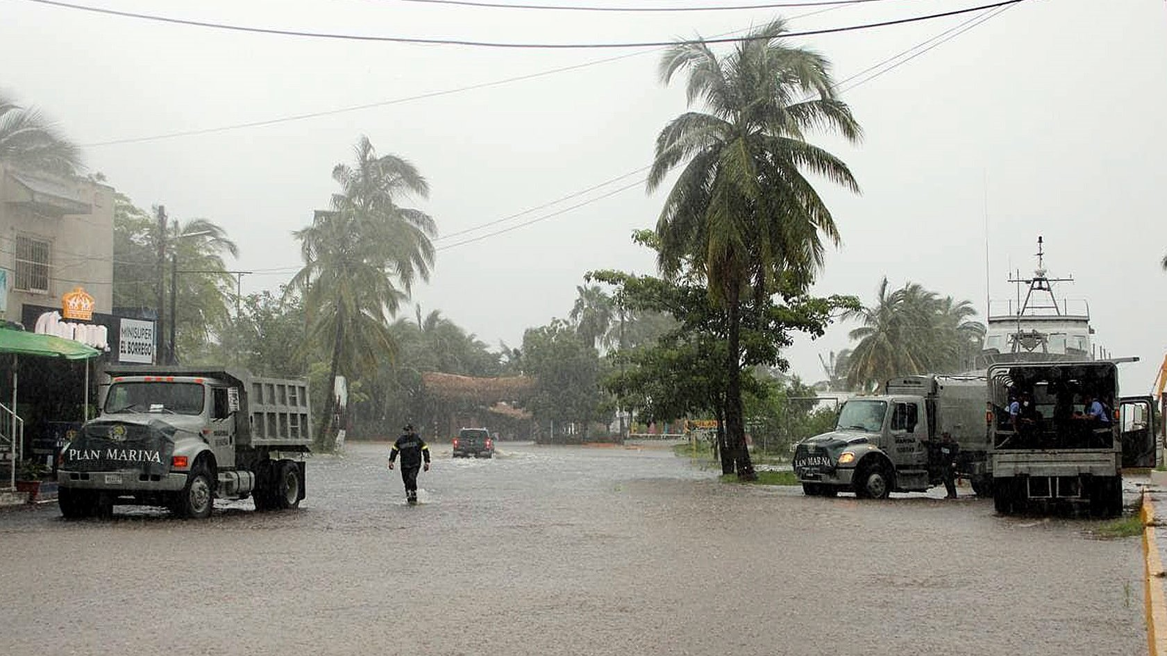epa09435787 Members of the Mexican Navy patrols in the areas affected by the heavy rains caused by Hurricane Nora in San Blas, Nayarit state, Mexico, 29 August 2021. Originated in the Pacific, Hurricane Nora runs Sinaloa, causing heavy rains in Nayarit and Jalisco states. Authorities are expecting Nora to turn into a tropical storm in the coming hours.  EPA/Aaron Garcia