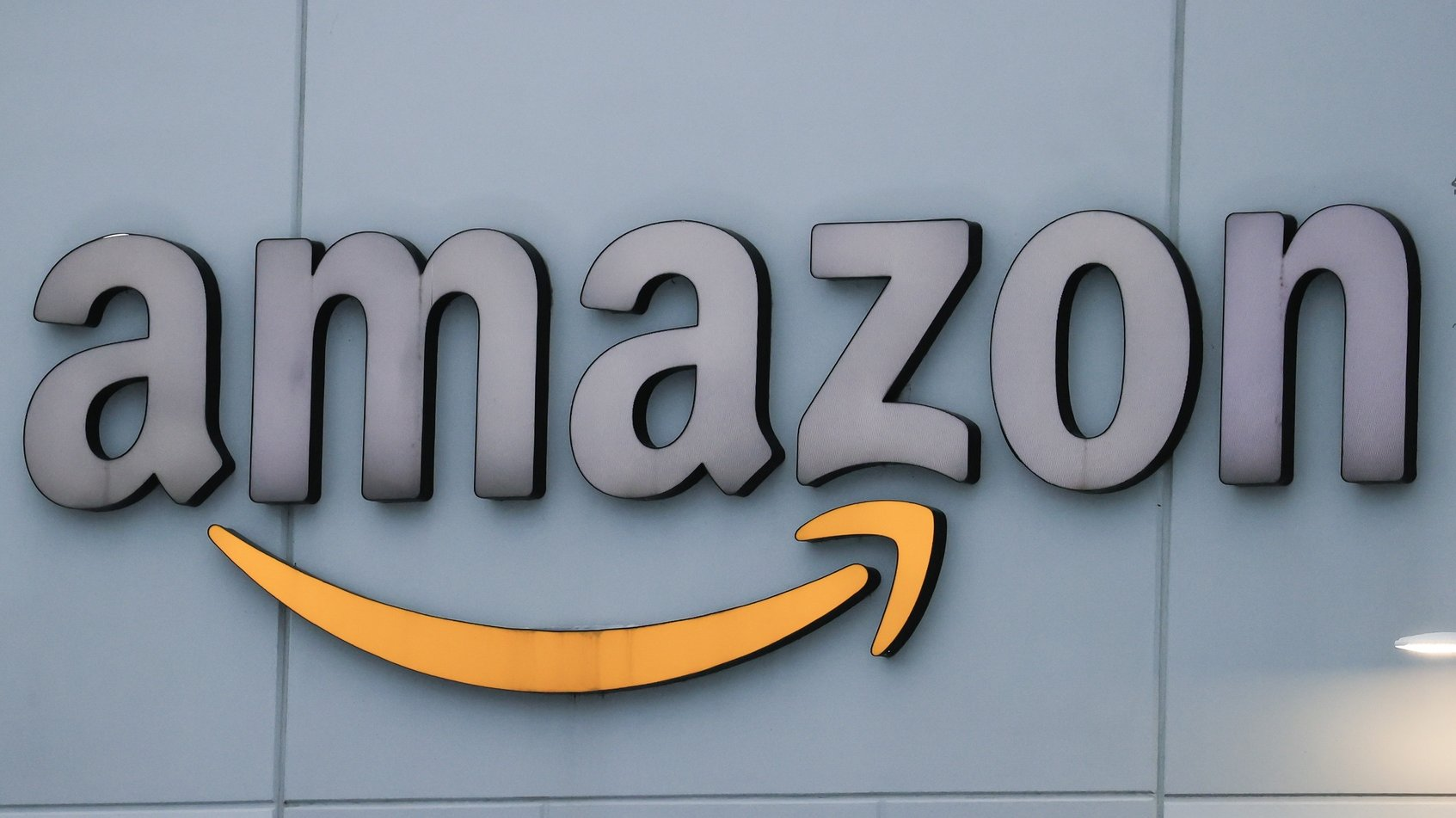 epa09193398 (FILE) An Amazon warehouse is outfitted with the Amazon logo in Waukegan, Illinois, USA, 02 February 2021 (reissued 12 May 2021). The EU Court in Luxembourg on 12 May 2021 annulled an order by the European Union demanding Amazon to pay about 250 million euros in taxes.  EPA/TANNEN MAURY