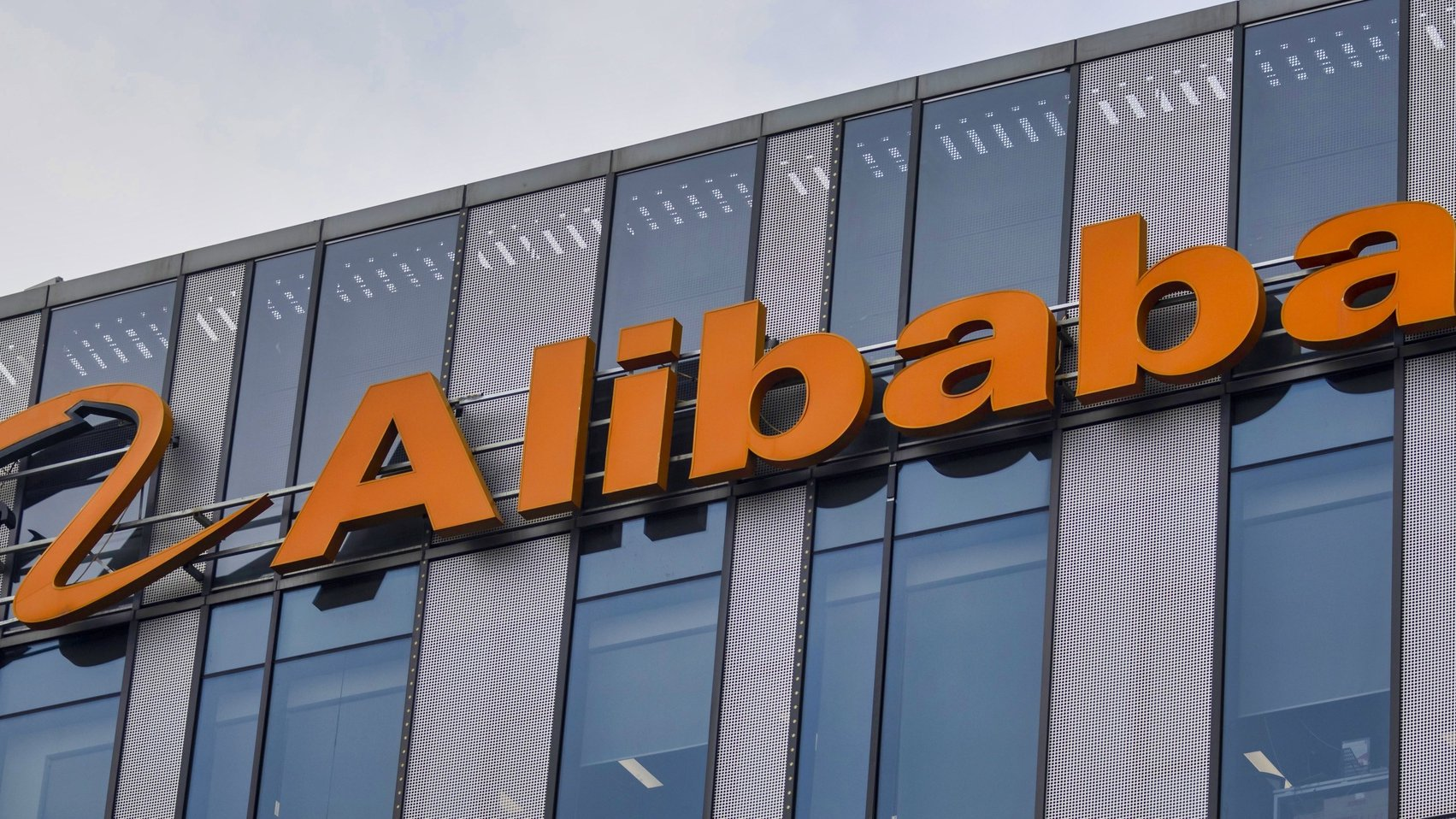 epa08798134 (FILE) - Alibaba logo is seen on their headquarters building in Shanghai, China, 21 July 2020 (reissued 04 November 2020). Alibaba is due to publish their 3rd quarter 2020 results on 05 November 2020.  EPA/ALEX PLAVEVSKI *** Local Caption *** 56227329
