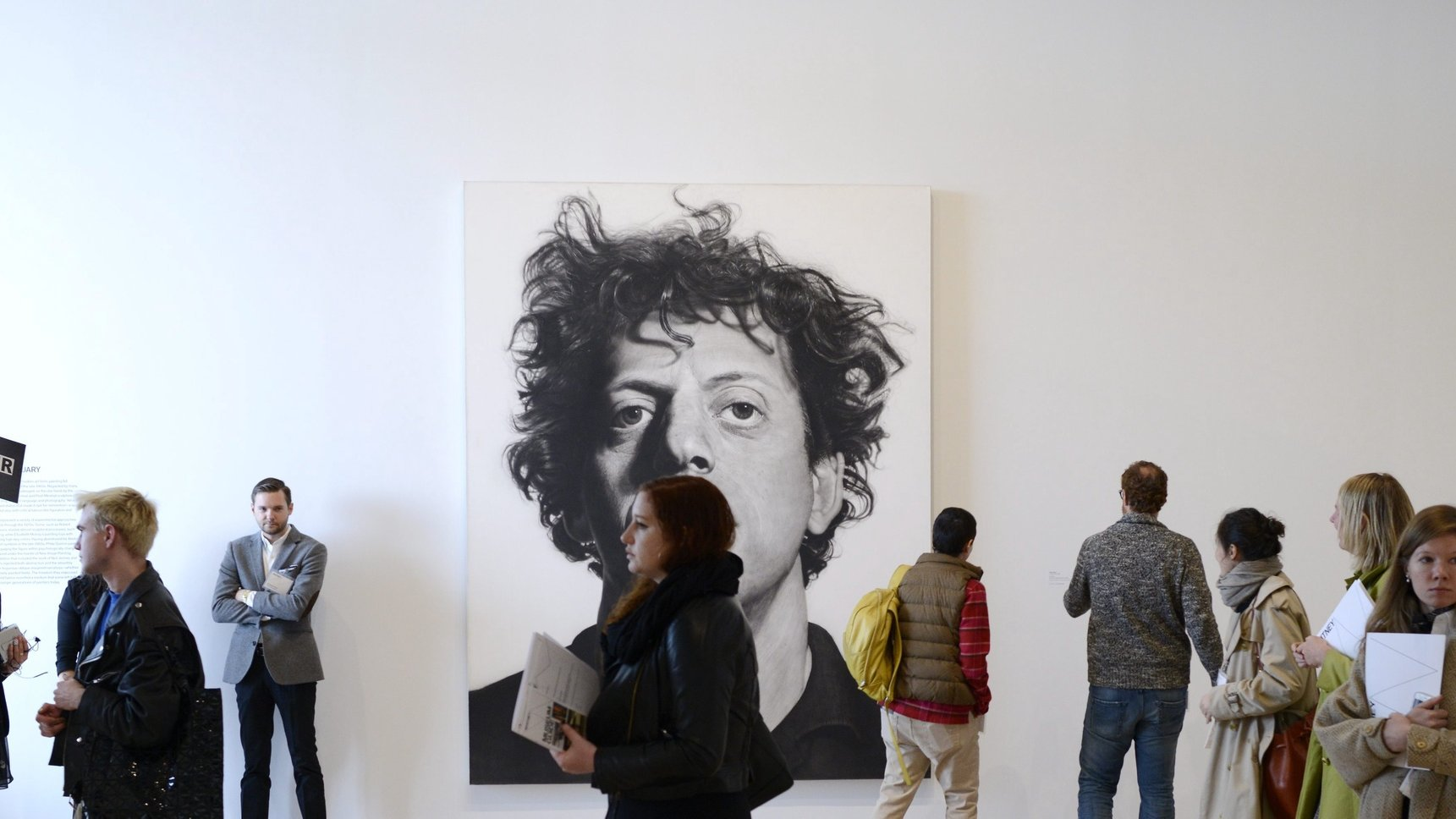 epa04717871 People look over the galleries and art, including a painting by artist Chuck Close, at the new Whitney Museum of American Art during a press preview in New York, New York, USA, 23 April 2015. The Whitney's new building, which was designed by Italian architect Renzo Piano, opens to the public on 01 May 2015.  EPA/JUSTIN LANE