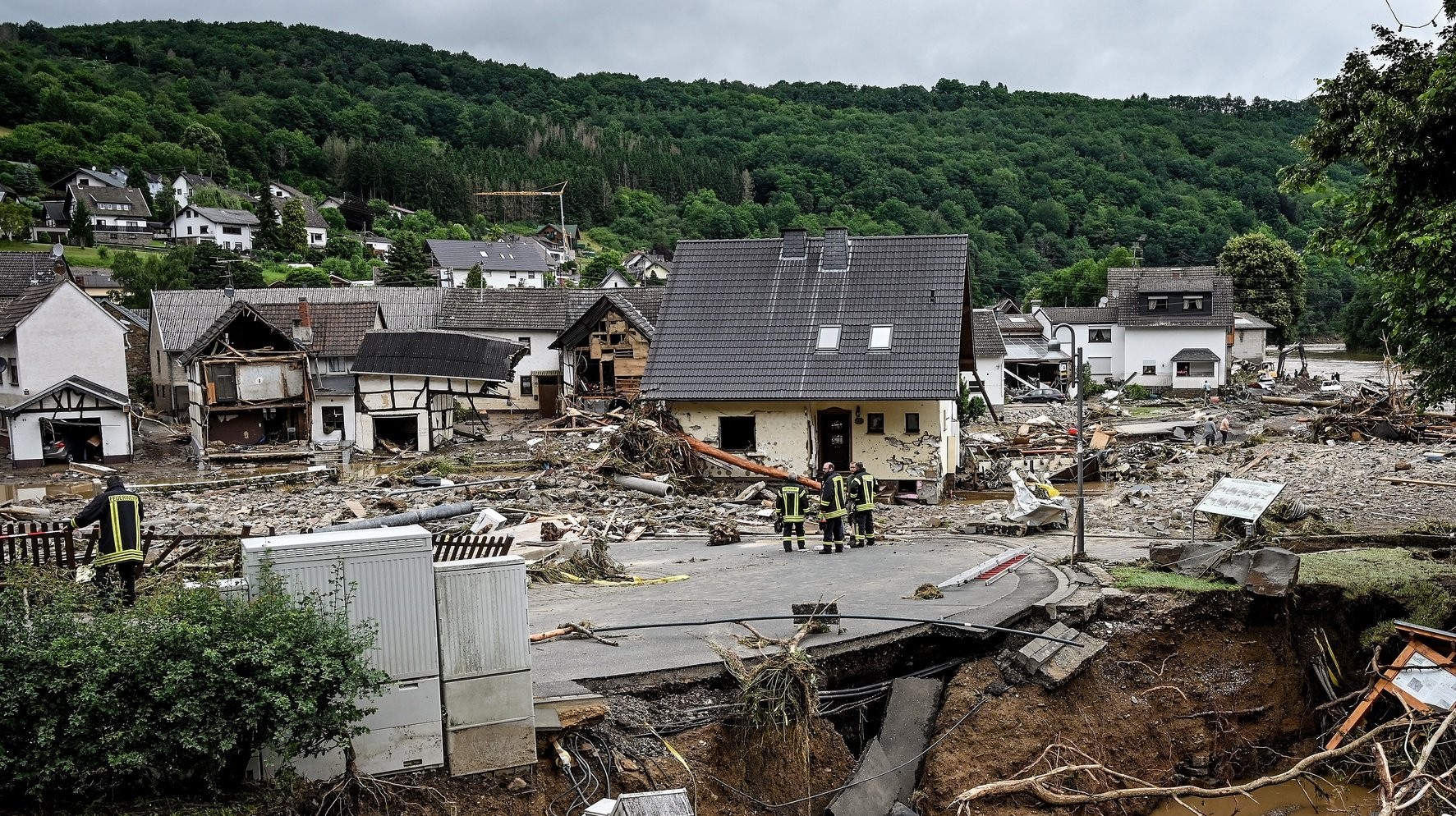 epa09346717 A view of the damage at village of Schuld in the district of Ahrweiler after heavy flooding of the river Ahr, in Schuld, Germany, 15 July 2021. Large parts of Western Germany were hit by heavy, continuous rain in the night to 14 July, resulting in local flash floods that destroyed buildings and swept away cars.  EPA/SASCHA STEINBACH