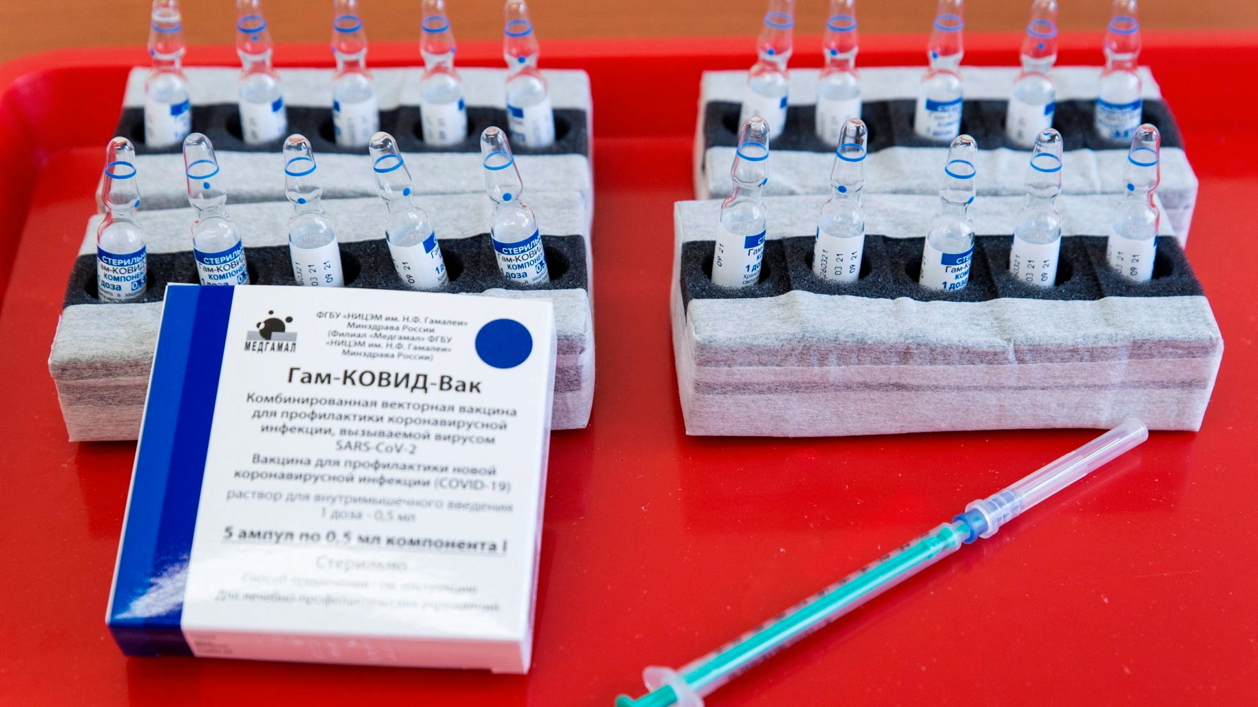 epa09142995 Vials of the Russian Sputnik V vaccine against COVID-19 are prepared to be inoculated to patients in the Petz Aladar Teaching Hospital in Gyor, Hungary, 18 April 2021, as the vaccination drive continues in the country.  EPA/Csaba Krizsan HUNGARY OUT