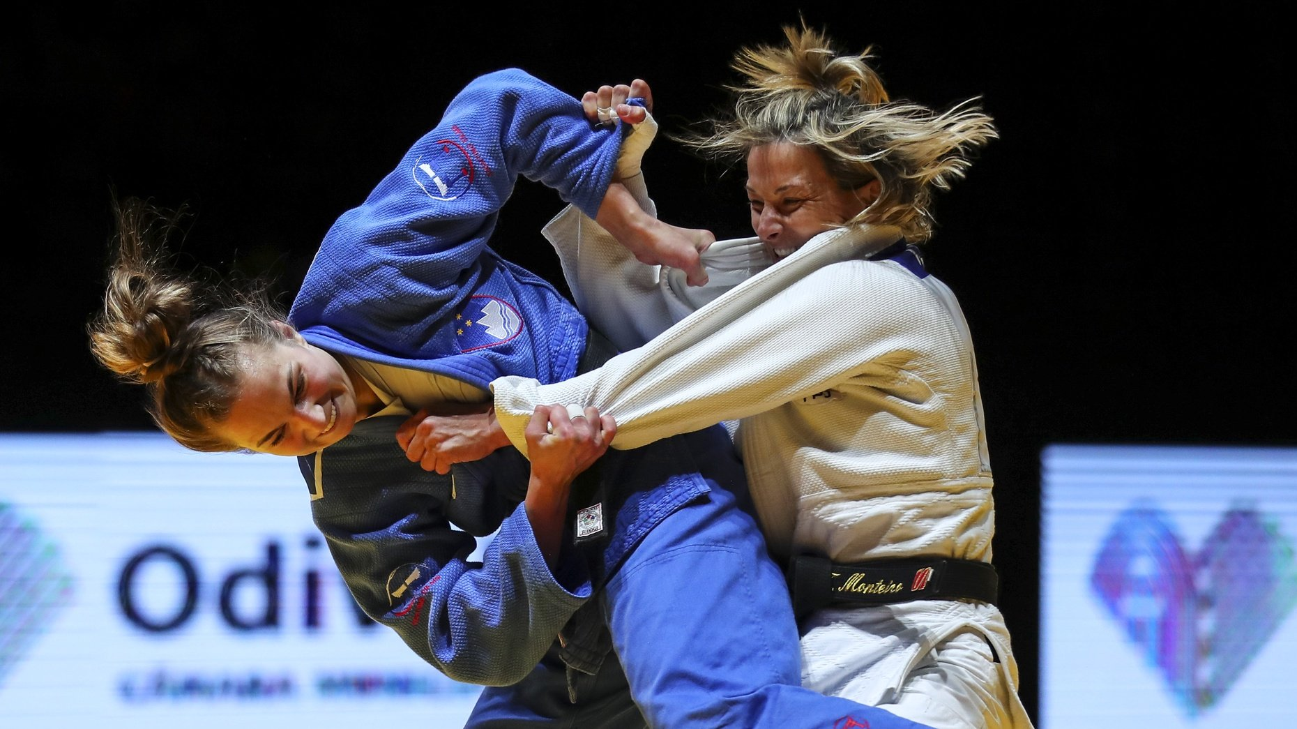 Telma Monteiro of Portugal (white) and Kaja Kajzer of Slovenia (blue) in action during the gold medal match in the woman's -57kg category at the European Judo Championships in Lisbon, Portugal, 16 April 2021. NUNO VEIGA/LUSA