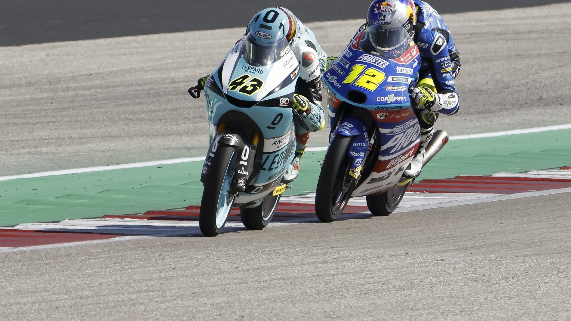 epa09503894 Spanish rider Xavier Artigas (L) of Leopard Racing and Czech rider Filip Salac (R) of Carxpert PruestelGP in action during the Moto3 race of the Motorcycling Grand Prix of the Americas at the Circuit Of The Americas in Austin, Texas, USA, 03 October 2021.  EPA/ERIK LESSER