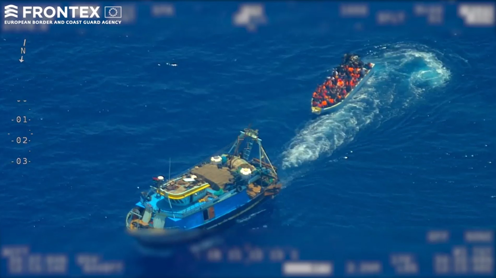 epa07669907 A screen grab taken from an undated handout video made available by the European Border and Coast Guard Agency (Frontex) on 22 June 2019 shows a fishing trawler (L) pulling away from a wooden boat with migrants on board, at high seas in the Mediterranean. According to Frontex, some 80 people emerged from below the deck of the fishing trawler -- a so-called 'mother boat' that people smugglers use to carry large groups of migrants across the sea -- and got into the smaller boat. After the migrant boat was filled with people it slowly headed toward the Italian island of Lampedusa as the fishing trawler quickly moved away. Frontex said that it used a plane and a drone to observe the fishing trawler and the boat with migrants for several hours; it also alerted Italian and Maltese authorities and the EUNAVFOR Med (Operation Sophia). Italian authorities, who are investigating the case, started a complex operation that caught up with the bigger vessel and arrested the suspected people smugglers and the migrant boat was intercepted in the Italian waters.  EPA/FRONTEX, THE EUROPEAN BORDER AND COAST GUARD AGENCY HANDOUT  HANDOUT EDITORIAL USE ONLY/NO SALES
