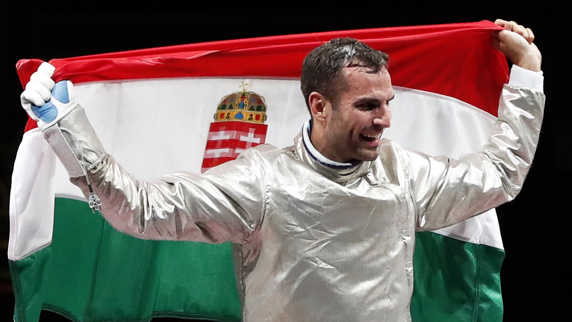 epa09362140 Aron Szilagyi of Hungary celebrates winning the gold medal during the men's Sabre individual Gold Medal Bout during the Fencing events of the Tokyo 2020 Olympic Games at the Makuhari Messe convention centre in Chiba, Japan, 24 July 2021.  EPA/KIYOSHI OTA