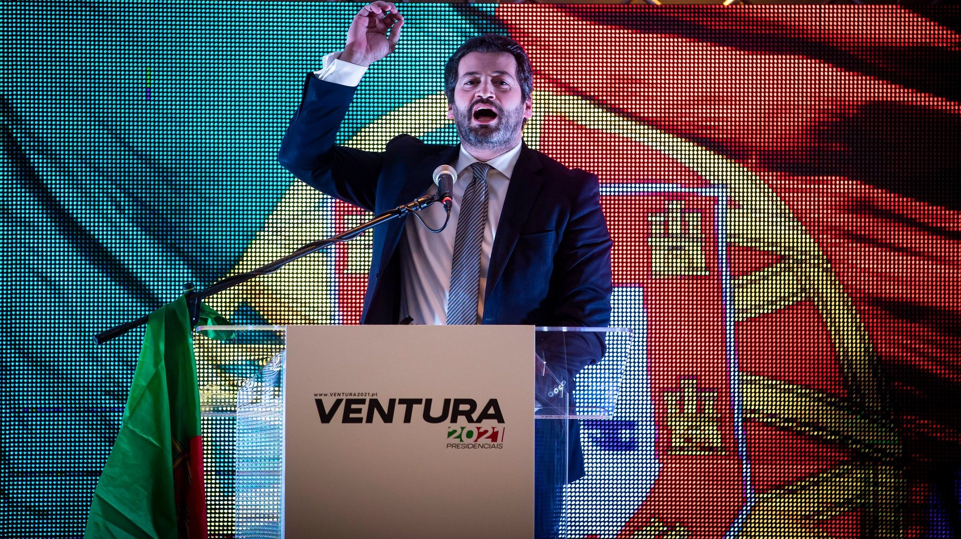 epa08963365 Portuguese presidential candidate for CHEGA party, Andre Ventura (C), addresses supporters after learning the results of the presidential election, at a Hotel in Lisbon, Portugal, 24 January 2021.  EPA/JOSE SENA GOULAO