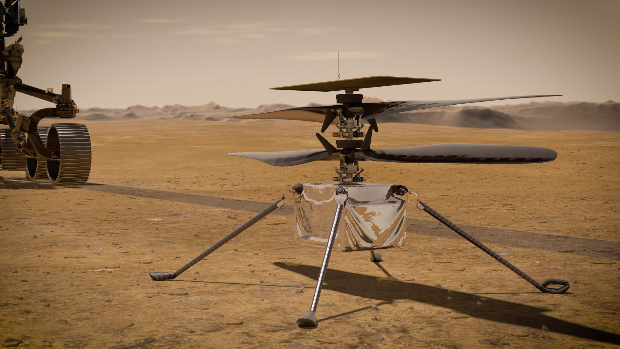 epa09112949 An undated handout artist's concept made available by NASA shows the Ingenuity Helicopter detached from NASA's Perseverance Mars rover, issued 03 April 2021. The helicopter is expected to fly in a dedicated fly zone no earlier than 08 April. Having landed on Mars on 18 February, Perseverance's main mission on Mars is astrobiology and the search for signs of ancient microbial life, according to NASA.  EPA/NASA/JPL-Caltech HANDOUT  HANDOUT EDITORIAL USE ONLY/NO SALES