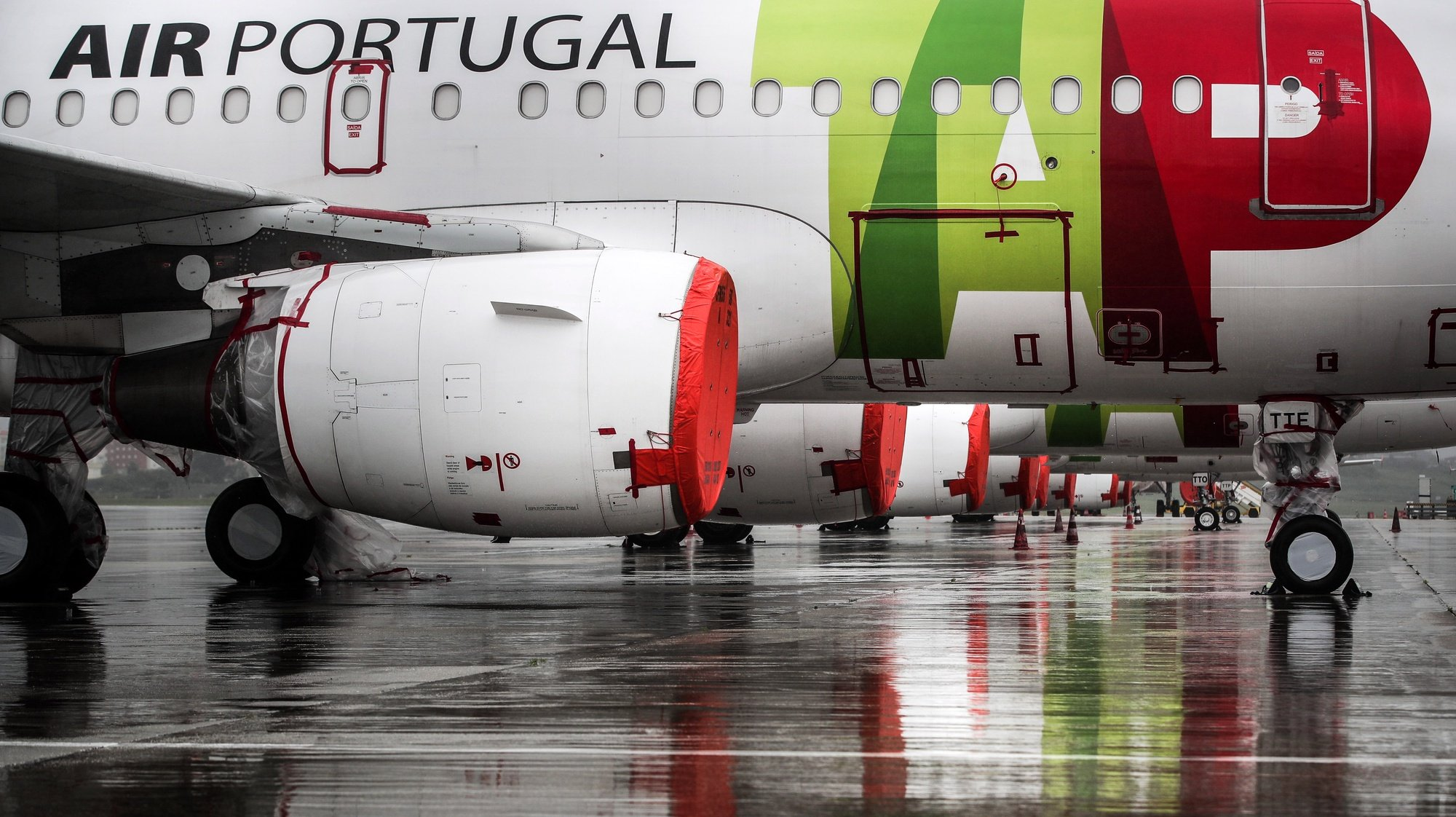 File photo dated from 09 April 2020 of TAP aircraft engines cover with plastic foil remain grounded at Humberto Delgado airport closed for passenger traffic as part of the exceptional traffic measures to combat the epidemiological situation of Covid-19, in Lisbon, Portugal, 09 April 2020 (reissued 02 July 2020). The granting of state support to TAP has been under discussion since the airline's activity came to a standstill because of the coronavirus pandemic, with an agreed injection of up to 1,200 million euros. MARIO CRUZ/LUSA
