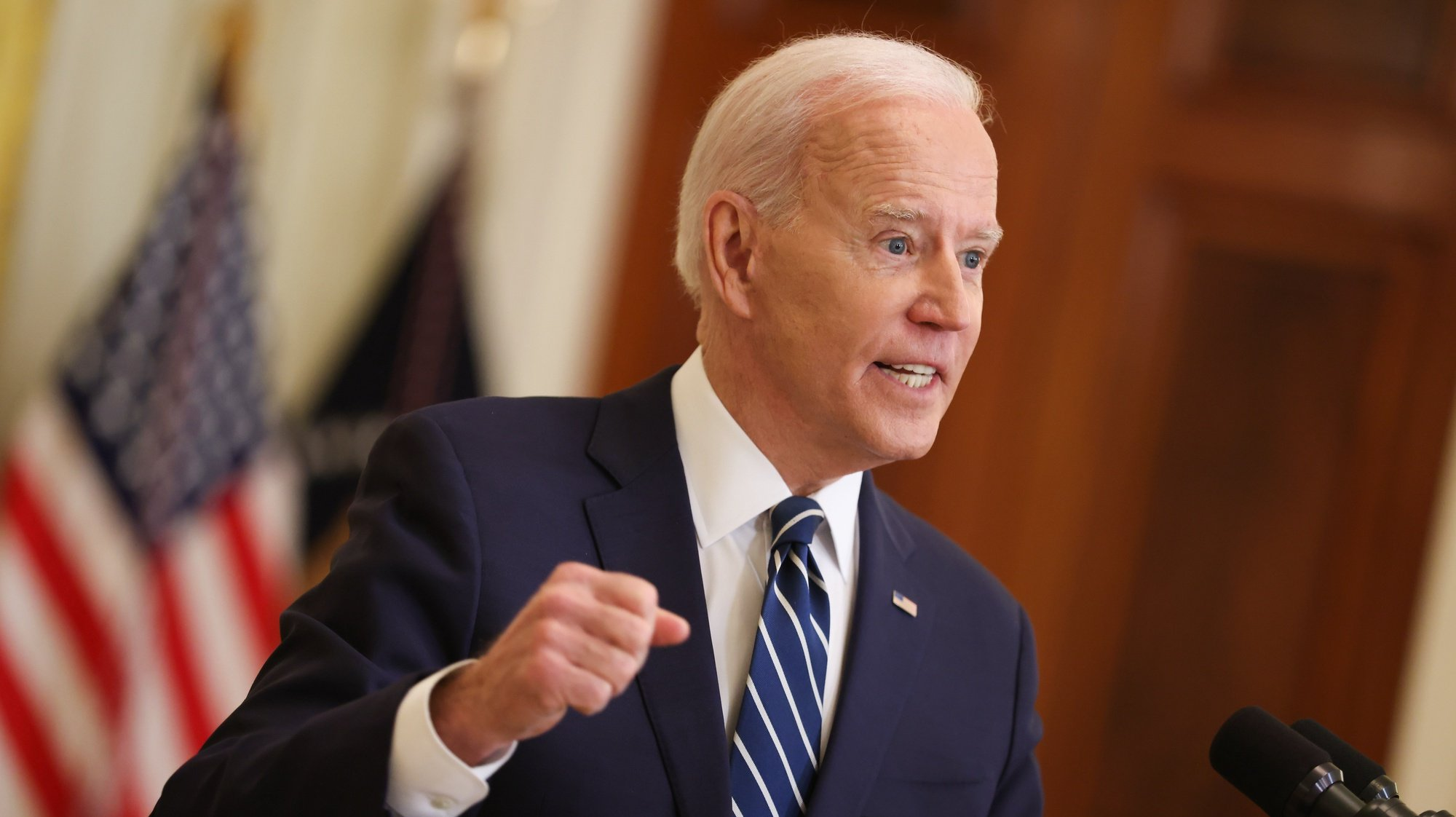 epa09097273 President Joe Biden speaks during the first formal press conference of his presidency in the East Room of the White House in Washington, in Washington, DC, USA, 25 March 2021.  EPA/OLIVER CONTRERAS / POOL