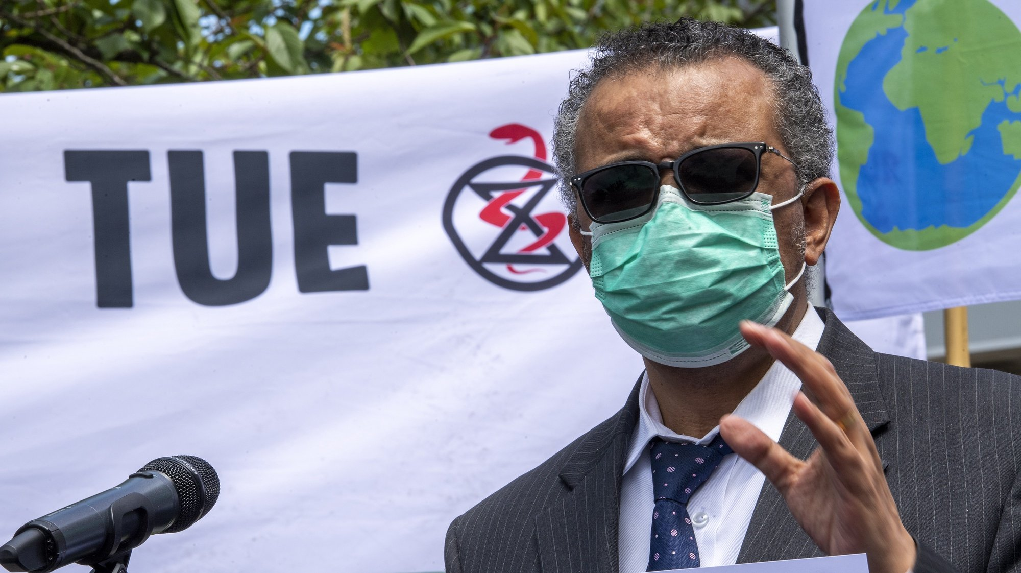 epa09234907 Director General of the World Health Organization (WHO), Tedros Adhanom Ghebreyesus meets members of the Doctors for Extinction Rebellion (XR) collective during a protest in front of the WHO headquarters on the sideline of the WHO's World Health Assembly in Geneva, Switzerland, 29 May 2021. Hundreds of health workers marched to the WHO demanding that authorities in all countries recognize and act to counter the health risks of climate change.  EPA/MARTIAL TREZZINI
