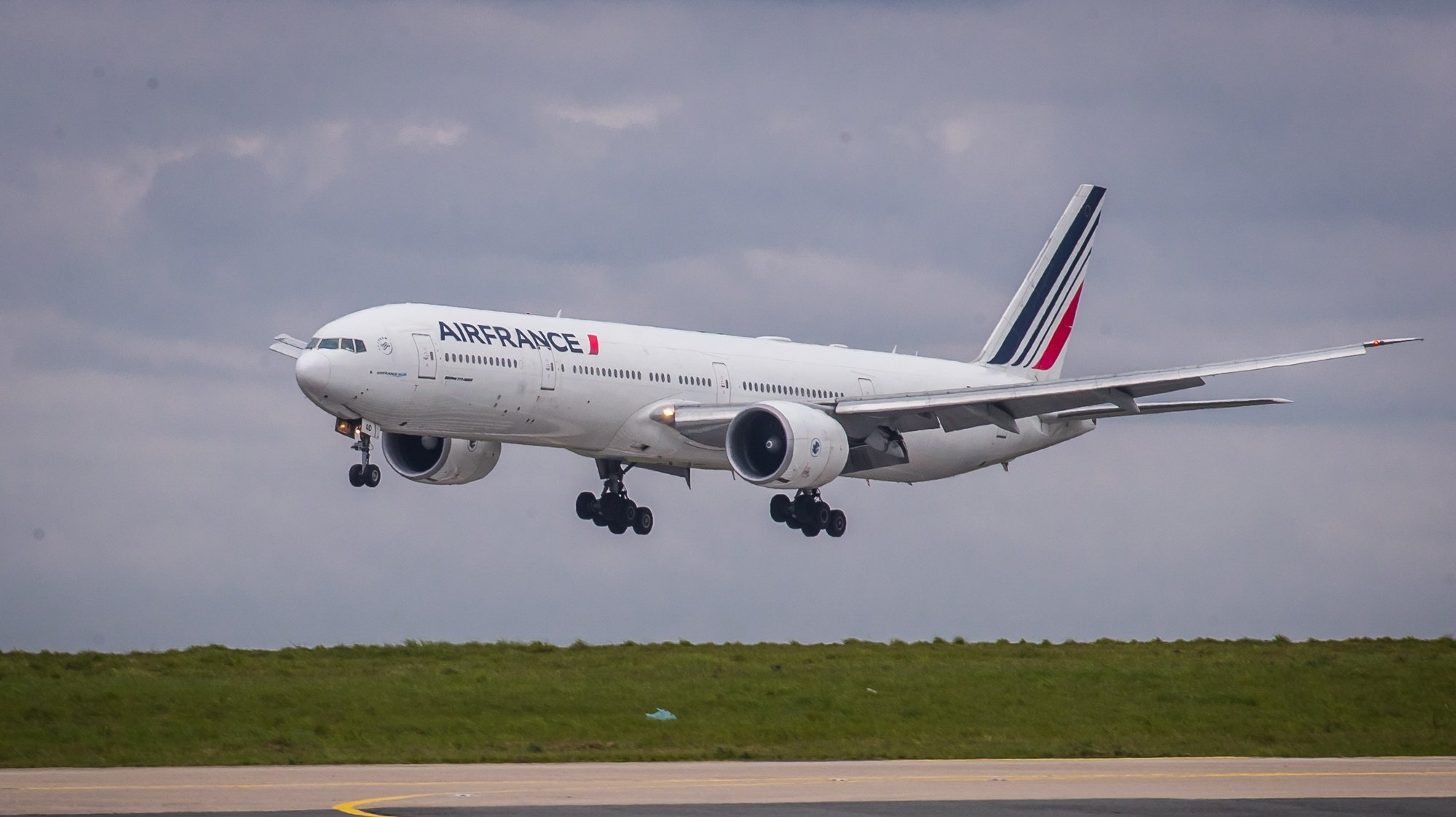 epa09130188 An Air France Boeing 777 take-off at Roissy Airport, near Paris, 11 April 2021 (issued 12 April 2021). Airline company Air France KLM Cargo, operated two flies to Cameroon and Colombia with a shipment of Chinese covid19 vaccines SinoPharm and SinoVac through its cargo area of Roissy airport (CDG).  EPA/CHRISTOPHE PETIT TESSON