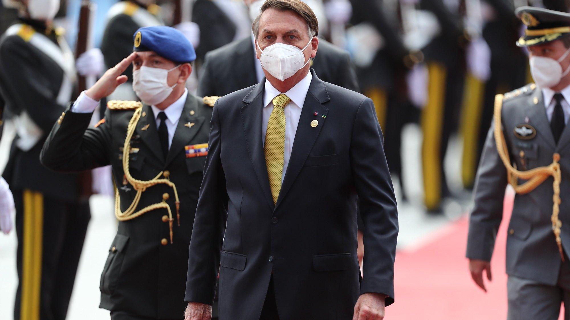 epa09225388 Brazil's President Jair Bolsonaro arrives for the inauguration ceremony of Ecuador's President-elect Lasso in Quito, Ecuador, 24 May 2021.  EPA/Jose Jacome