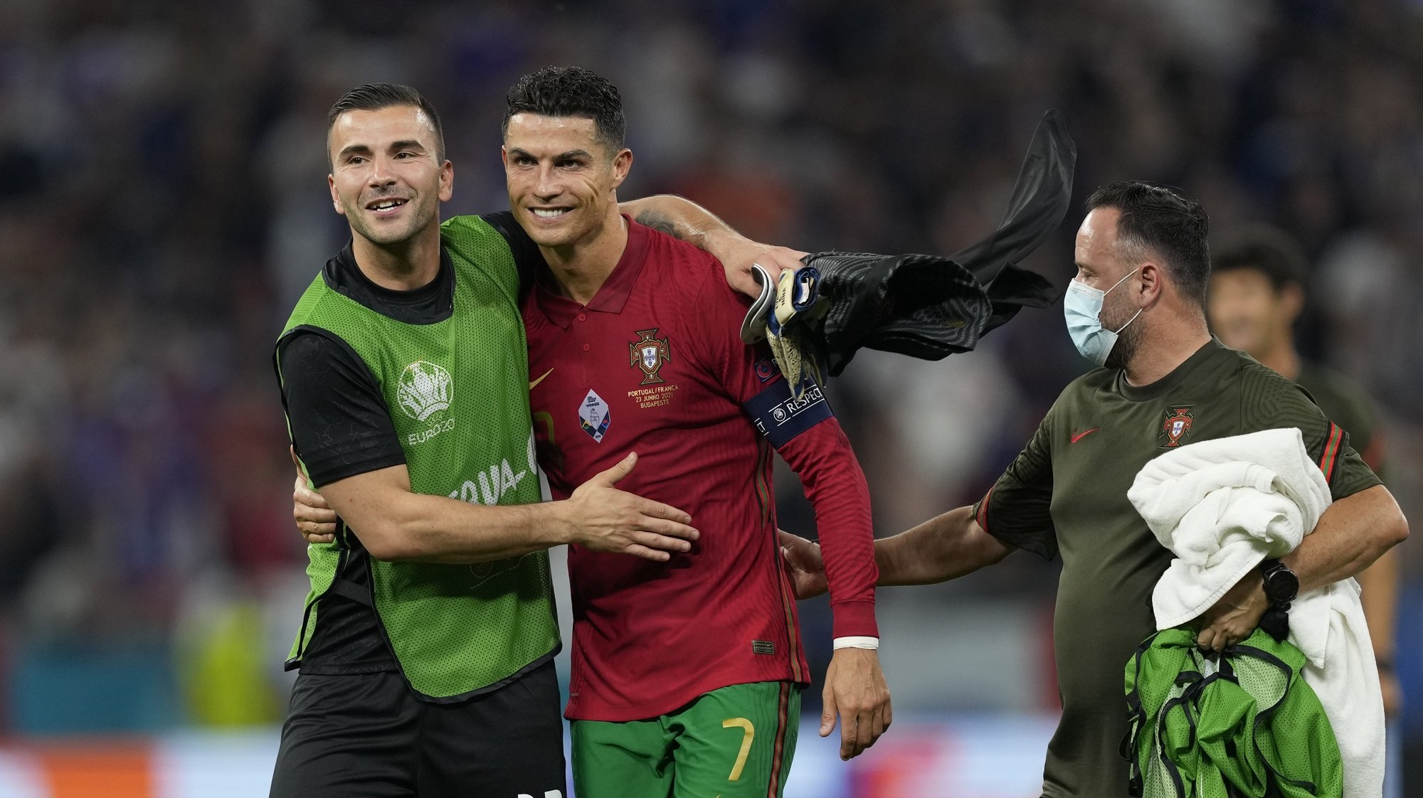 Portugal players Cristiano Ronaldo and Anthony Lopes celebrate after the UEFA EURO 2020 group F preliminary round soccer match between Portugal and France in Budapest, Hungary, 23 June 2021. HUGO DELGADO/LUSA