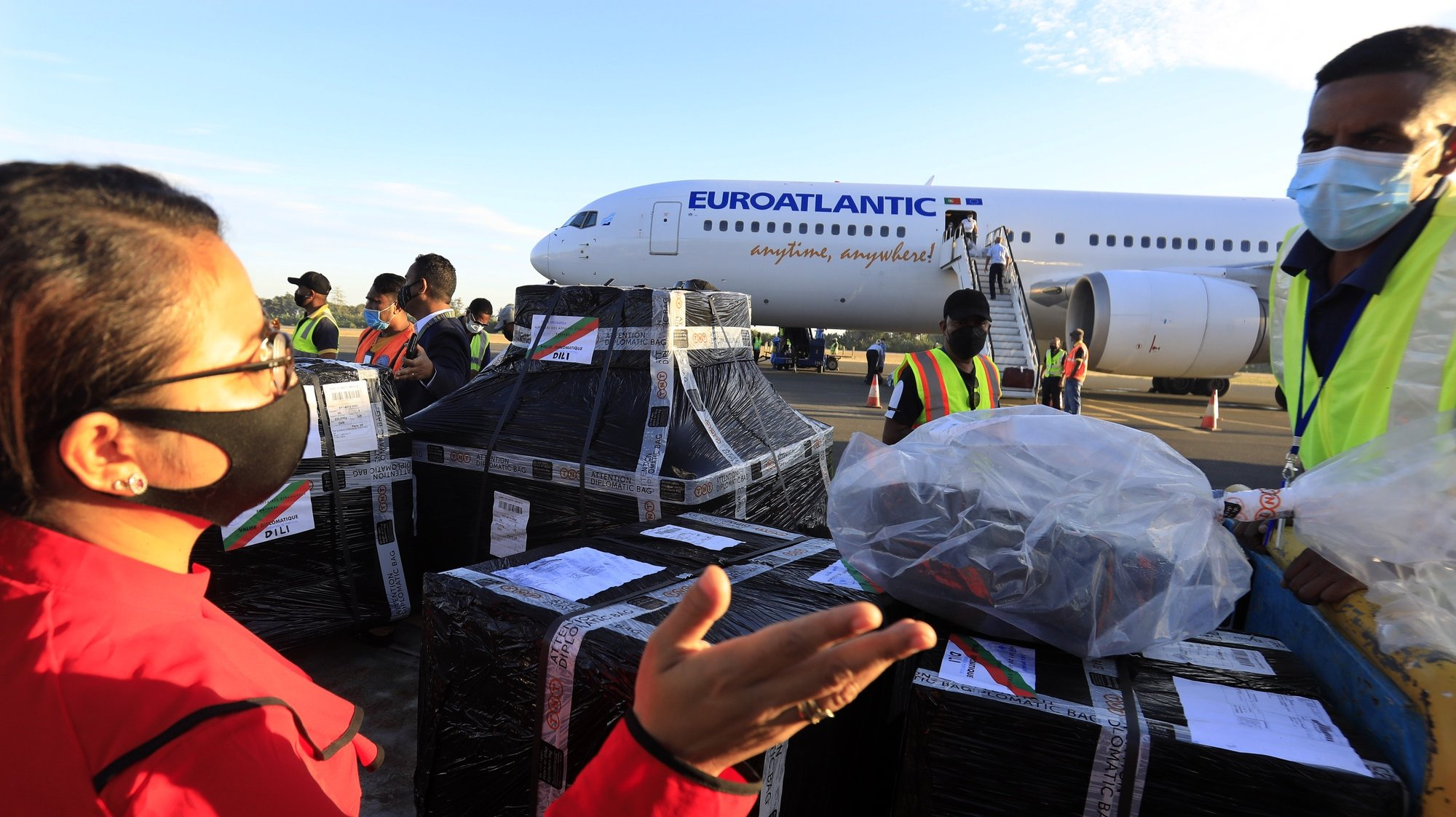epa09354031 Workers unload AstraZeneca (Vaxzevria) Covid-19 vaccines donated by Portugal's government from an airplane during the arrival at Nicolau Lobato International Airport in Dili, East Timor, also known as Timor Leste, 20 July 2021. East Timor has recorded more than 10,000 coronavirus disease (COVID-19) cases since the beginning of the pandemic.  EPA/ANTONIO DASIPARU