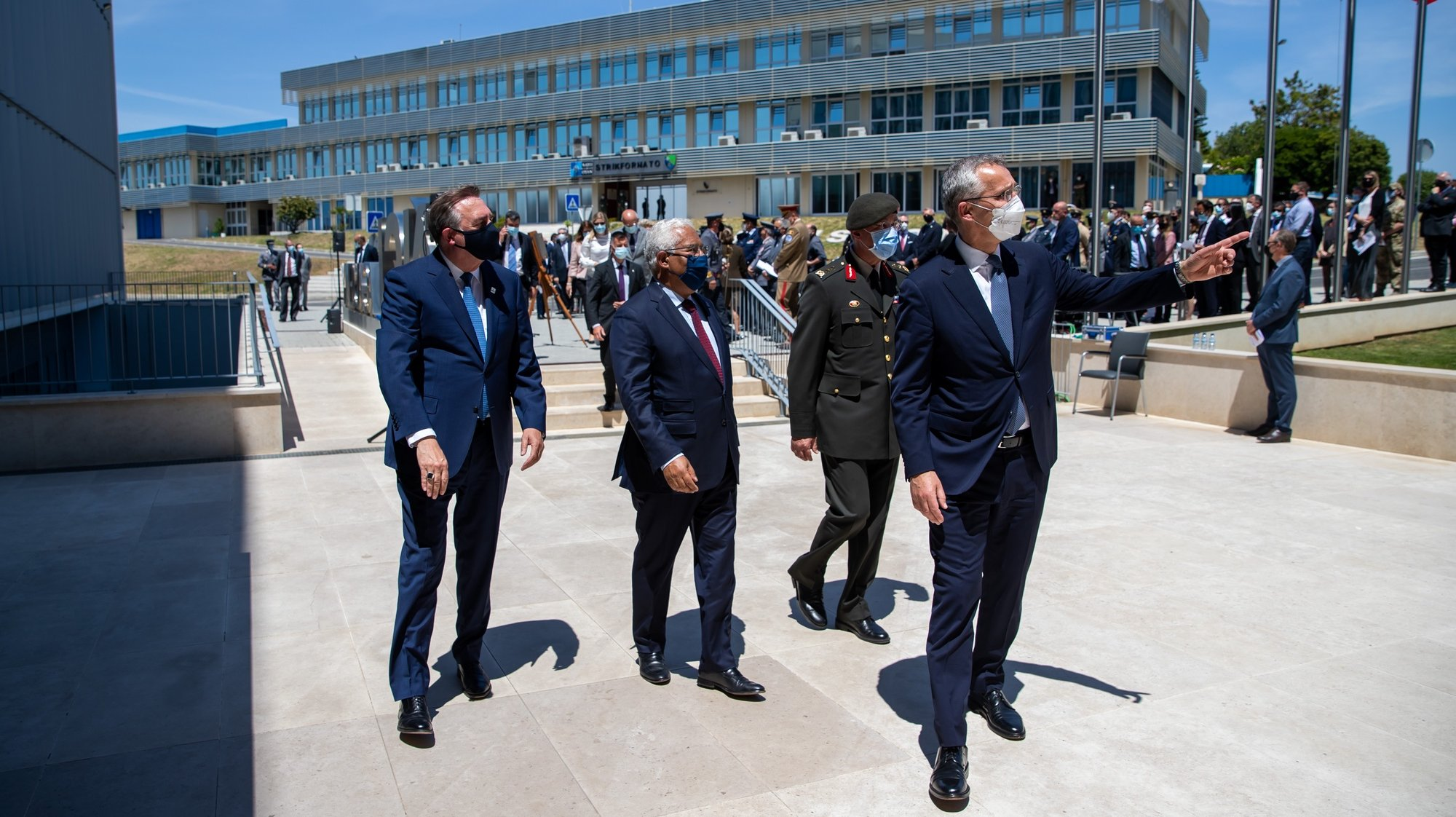NATO Secretary General Jens Stoltenberg (R) and Portuguese Prime-Minister, Antonio Costa (2-L),  during the inauguration of the Information Systems and Comunications School, at the NATO headquarters in Oeiras, Portugal,  26 May 2021.  JOSE SENA GOULAO/LUSA