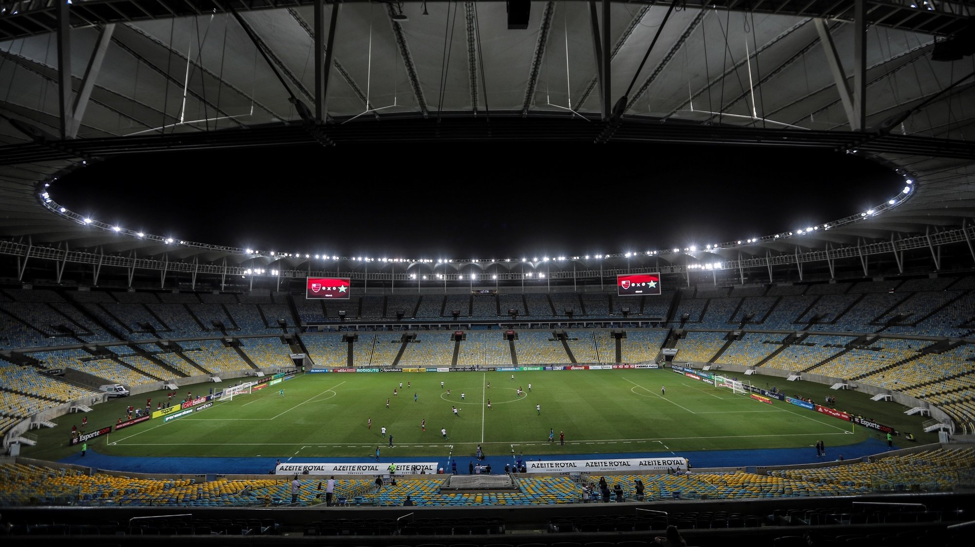 epa08294895 General view of the Maracana without fans during the game between Flamengo Vs. Portuguesa for the Rio de Janeiro soccer championship, in the empty Maracana stadium, in Rio de Janeiro, Brazil, 14 March 2020. The soccer matches scheduled for today and tomorrow in most Brazilian stadiums, including Rio de Janeiro and Sao Paulo, will be behind closed doors, over fears that large public gatherings will facilitate the expansion of the coronavirus in Brazil.  EPA/Antonio Lacerda