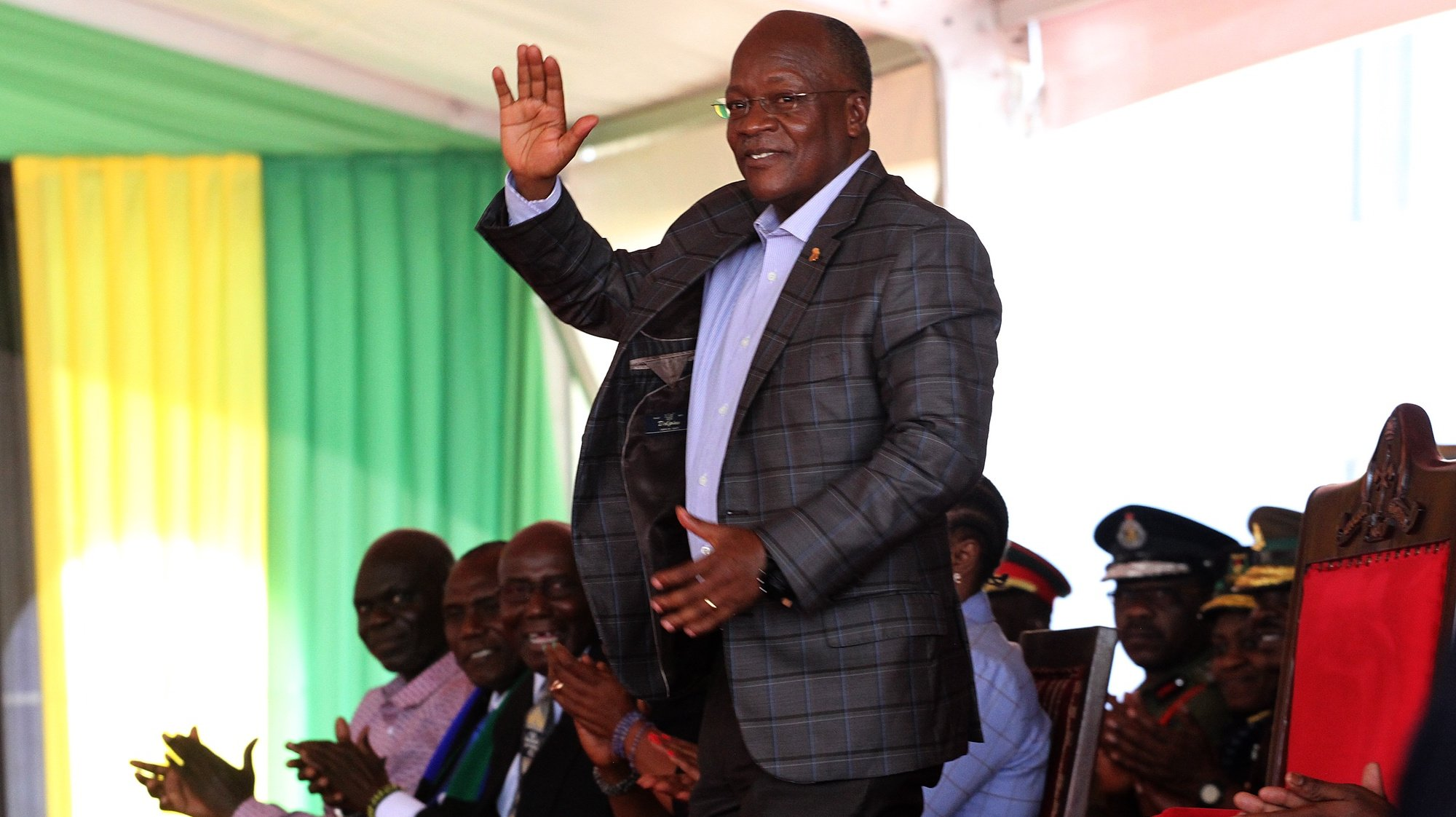 epa08790463 President John Magufuli (C) formally accepts presidential winner's certificate after winning another 5 year term after the recent elections, Dodoam, Tanzania,  01 November 2020. Incumbent President John Magufuli won in a crowded field of 15 contenders. He is the candidate of the Chama Cha Mapinduzi (CCM) party which has led Tanzania since independence in 1961.  EPA/ANTHONY SIAME