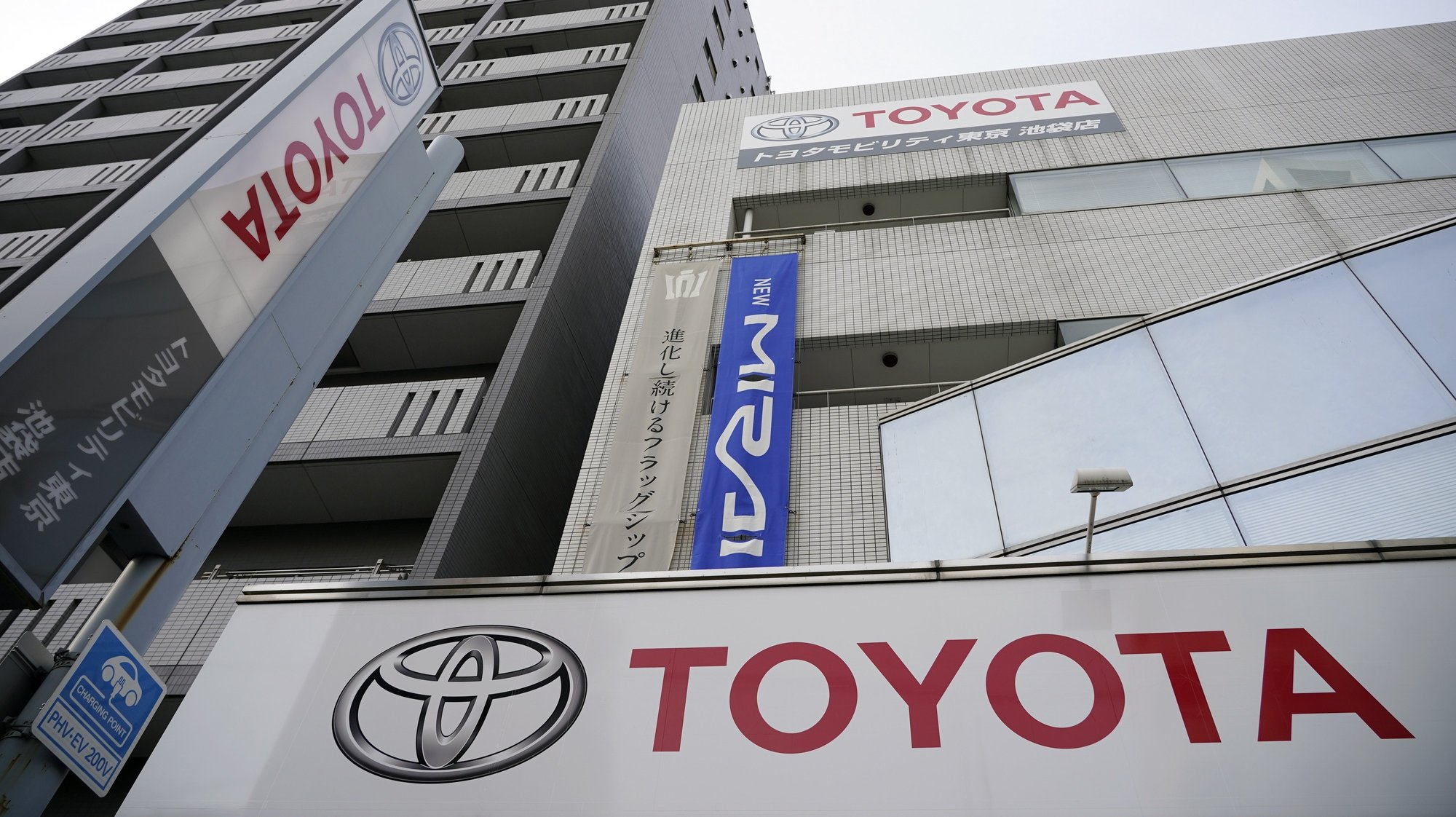 epa09000537 The Toyota Motor logo hangs outside the carmaker's retailer in Tokyo, Japan, 10 February 2021. Toyota Motor Corp. announced its financial forecast for the fiscal year 2021.  EPA/FRANCK ROBICHON