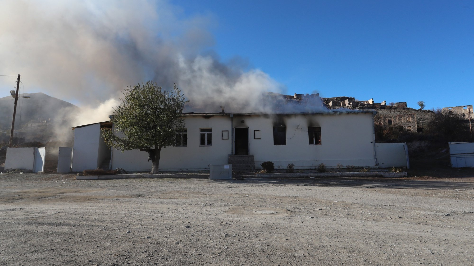 epa08839845 A house burns in the town of Kalbajar ( Karvatchar) in Kalbajar region, Azerbaijan, 24 November 2020, before the handover of the region under Azerbaijan's control. On 09 November 2020 Presidents of Azerbaijan and Russia and Armenian Prime Minister signed a trilateral statement announcing a ceasefire and the halt of all military operations in the Nagorno-Karabakh conflict zone, where clashes had erupted on 27 September 2020 between Azerbaijan and Armenia over the Nagorno-Karabakh territory along the contact line of the self-proclaimed Nagorno-Karabakh Republic (also known as Artsakh).  EPA/HAYK BAGHDASARYAN /PHOTOLURE MANDATORY CREDIT