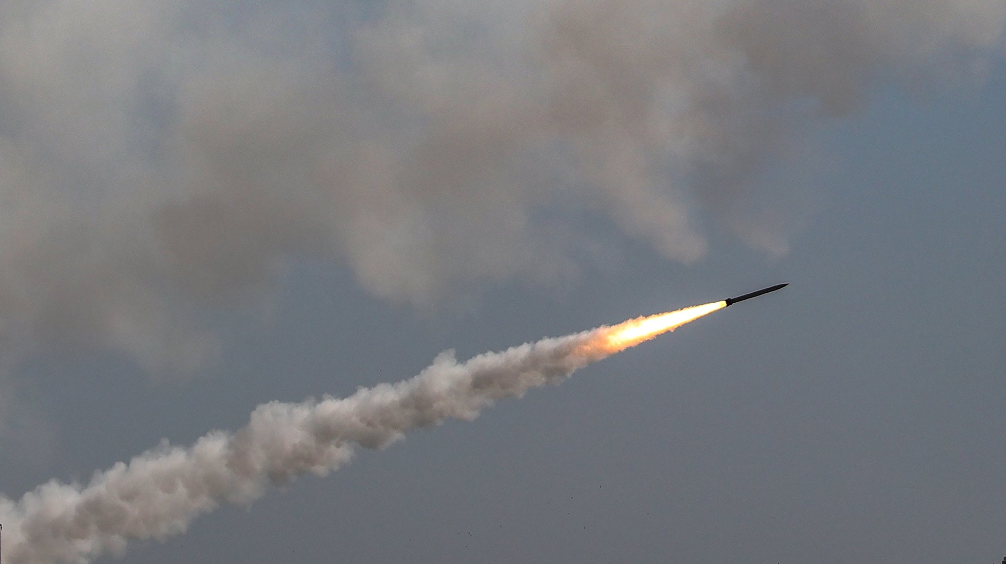 epa09195315 Rockets fired from Gaza fly towards Israel, as seen from Gaza City, 12 May 2021. In response to days of violent confrontations between Israeli security forces and Palestinians in Jerusalem, various Palestinian militants factions in Gaza launched rocket attacks since 10 May that killed at least six Israelis to date. Gaza Strip's health ministry said that at least 65 Palestinians, including 13 children, were killed in the recent retaliatory Israeli airstrikes. Hamas confirmed the death of Bassem Issa, its Gaza City commander, during an airstrike.  EPA/MOHAMMED SABER