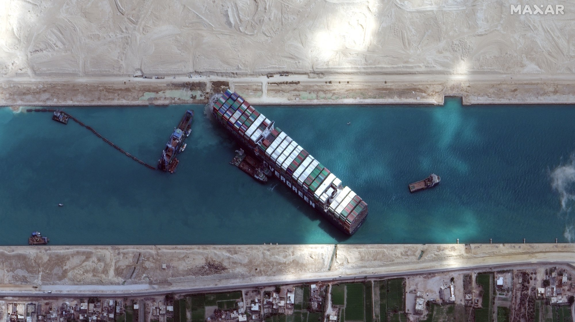 epa09103099 A handout satellite image made available by MAXAR Technologies shows excavation around the bow of the 'Ever Given' and dredging operations in progress, in the Suez Canal, Egypt, 28 March 2021. The large container ship Ever Given ran aground in the Suez Canal on 23 March, blocking passage of other ships and causing a traffic jam for cargo vessels.  EPA/MAXAR TECHNOLOGIES HANDOUT MANDATORY CREDIT: SATELLITE IMAGE 2020 MAXAR TECHNOLOGIES -- the watermark may not be removed/cropped -- HANDOUT EDITORIAL USE ONLY/NO SALES