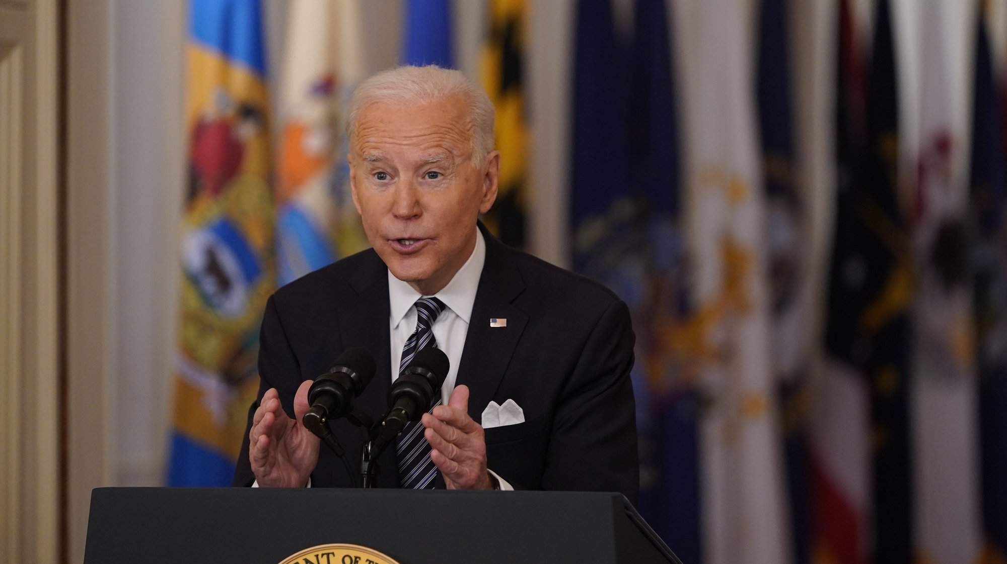 epa09068941 US President Joe Biden delivers a nationally televised address to the nation on the one-year anniversary of the COVID-19 pandemic shutdown in the East Room of the White House in Washington, DC, USA, 11 March 2021.  EPA/Chris Kleponis / POOL
