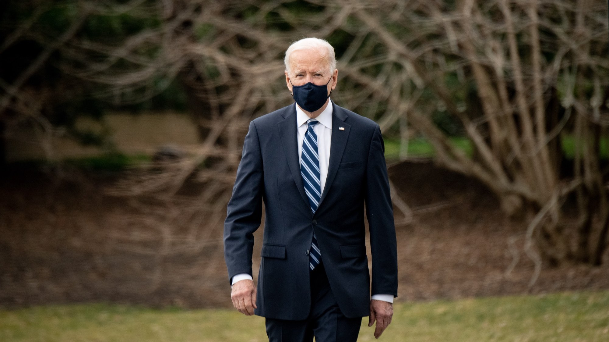 epa09078505 US President Joe Biden walks on the South Lawn of the White House before boarding Marine One in Washington, DC, USA, 16 March 2021. Biden, traveling to Pennsylvania, is fanning out across the country along with the Vice President and their spouses to highlight Americans receiving stimulus checks and coronavirus vaccines, as well as businesses that have been able to stay afloat with government loans.  EPA/ERIN SCOTT / POOL