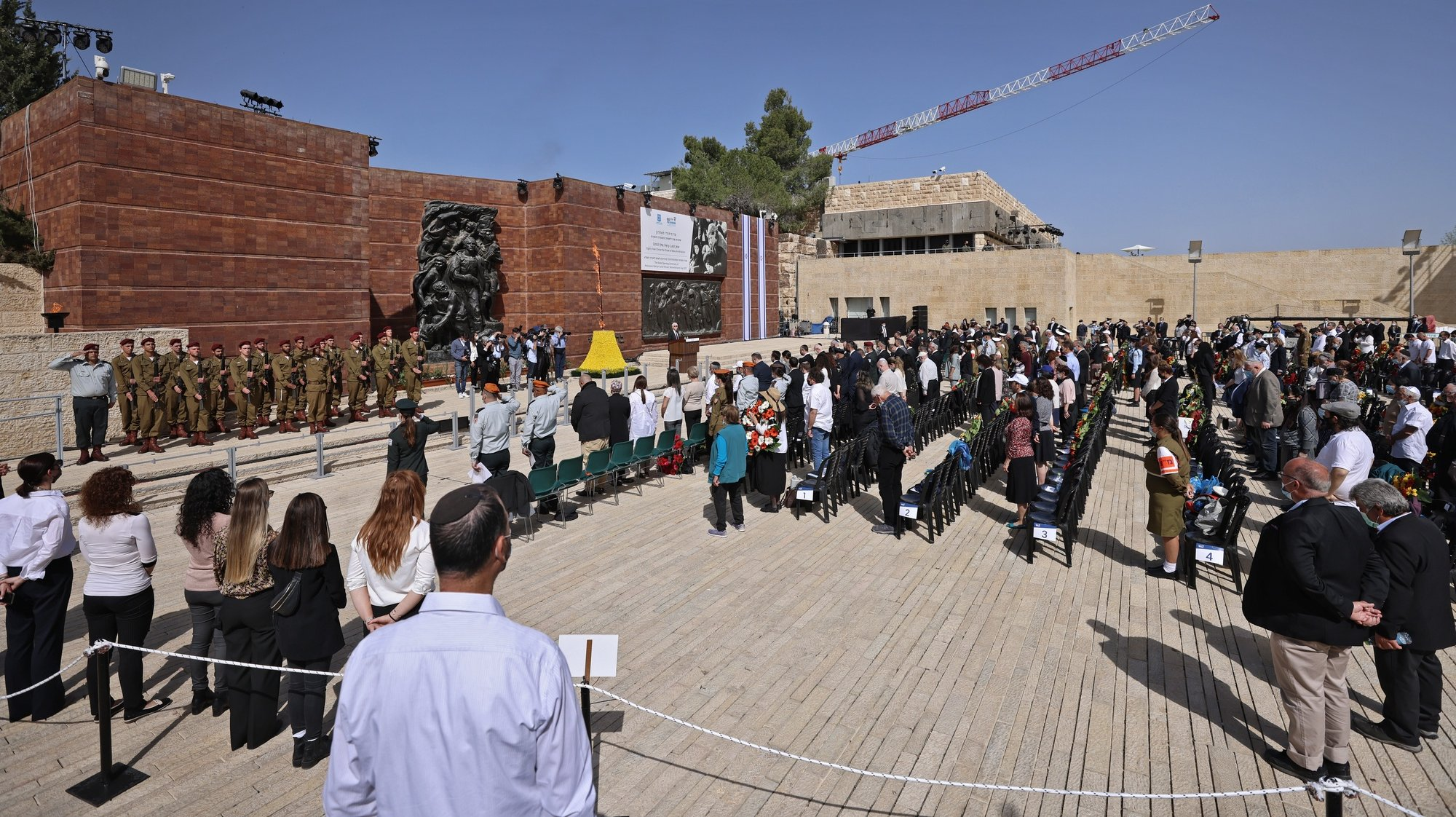 epa09121793 A general view shows a wreath-laying ceremony marking the Holocaust Remembrance Day at Warsaw Ghetto Square in Jerusalem's Yad Vashem memorial on 08 April 2021.  EPA/EMMANUEL DUNAND / POOL