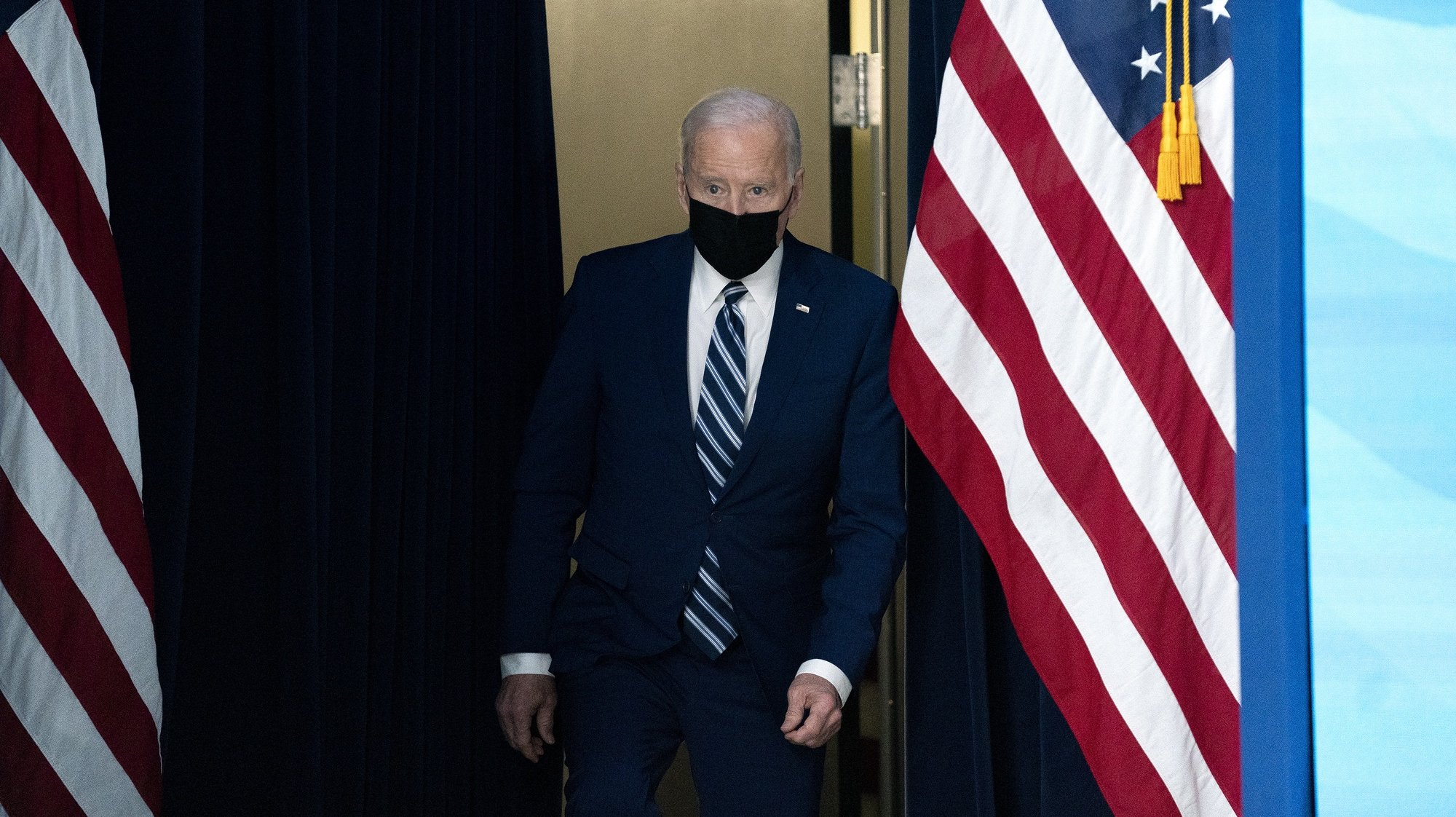 epa09105437 US President Joe Biden arrives to deliver remarks on the state of the Covid-19 vaccine in the South Court Auditorium of the White House in Washington, DC, USA, on 29 March 2021.  EPA/Stefani Reynolds / POOL