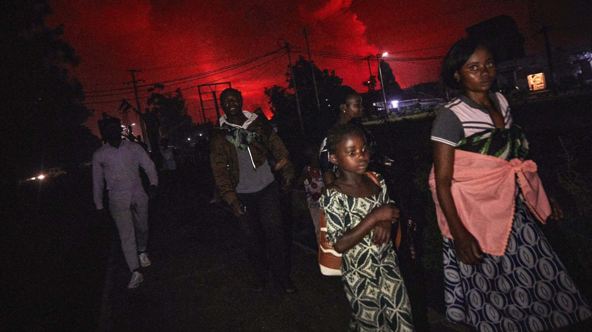 epaselect epa09221145 Congolese residents of Goma flee from Mount Nyiragongo volcano as it erupts over Goma, Democratic Republic of the Congo, 22 May 2021. One of the planets most active volcanoes Mount Nyiragongo in eastern Democratic Republic of Congo erupted causing evacuations in some parts of Goma. Initial reports from scientists predict the city is not in danger from the lava.  EPA/HUGH KINSELLA CUNNINGHAM