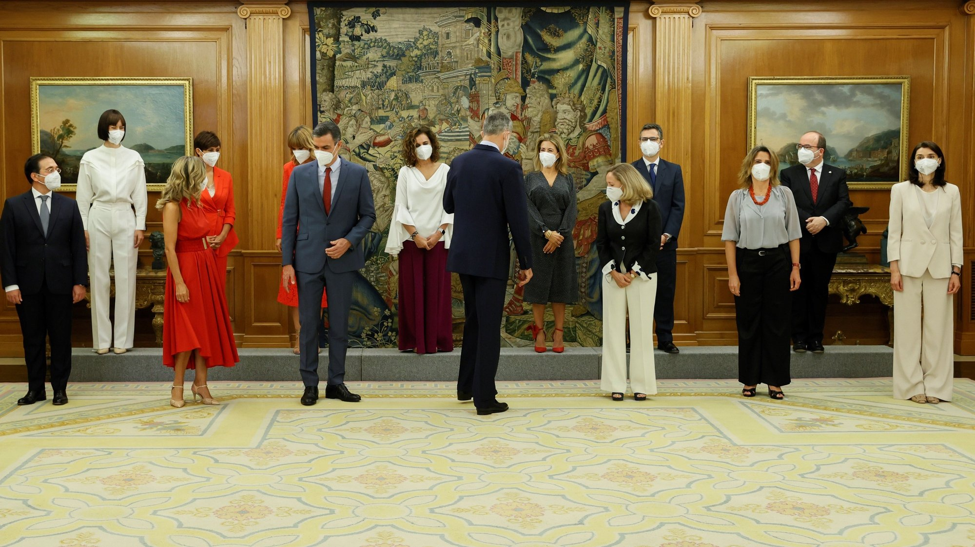 epa09339637 Spain's King Felipe VI (C, front) and Spanish Prime Minister Pedro Sanchez (3L, front) prepare to pose for a family photo with the new members of Spanish Cabinet during the swearing-in ceremony at La Zarzuela Palace, in Madrid, Spain, 12 July 2021. Spanish Prime Minister Pedro Sanchez announced a deep change in his Cabinet aimed to boost economic recovery after the impact of COVID-19 pandemic.  EPA/BALLESTEROS / POOL