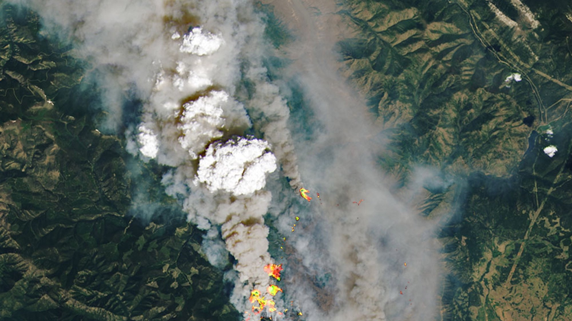 epa09316834 A handout satellite image made available by the National Aeronautics and Space Administration (NASA) shows a detailed view of the McKay Creek fire, some 23km north of the community of Lillooet, British Columbia (BC), Canada, 30 June 2021 (issued 02 July 2021). This natural-color satellite image was overlaid at source with shortwave-infrared light to highlight the active fire. More than 40 wildfires were burning across the Canadian province by the end of June 2021, according to data released by the BC Wildfire Service. A heatwave has hit Canada and north-west USA sending temperatures to dangerous highs.  EPA/NASA HANDOUT  HANDOUT EDITORIAL USE ONLY/NO SALES