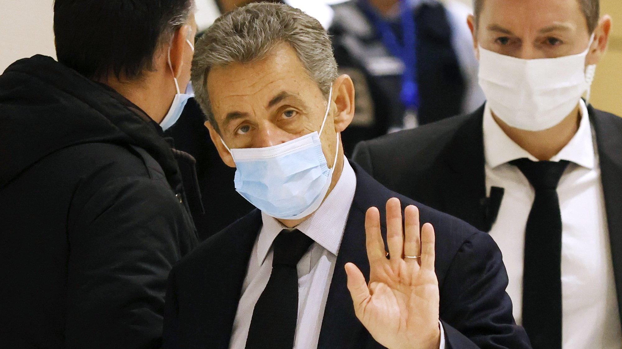 epa08874538 Former French president Nicolas Sarkozy (C) arrives at the court for his trial on corruption charges in the so-called 'wiretapping affair' in Paris, France, 10 December 2020. In 2013, Nicolas Sarkozy was using a false name, Paul Bismuth, to make phone calls to his lawyer, Thierry Herzog, about the decision that the Court of Cassation was about to take regarding the seizure of presidential diaries in a separate case. The trial is due to run from 23 November to 10 December 2020.  EPA/YOAN VALAT