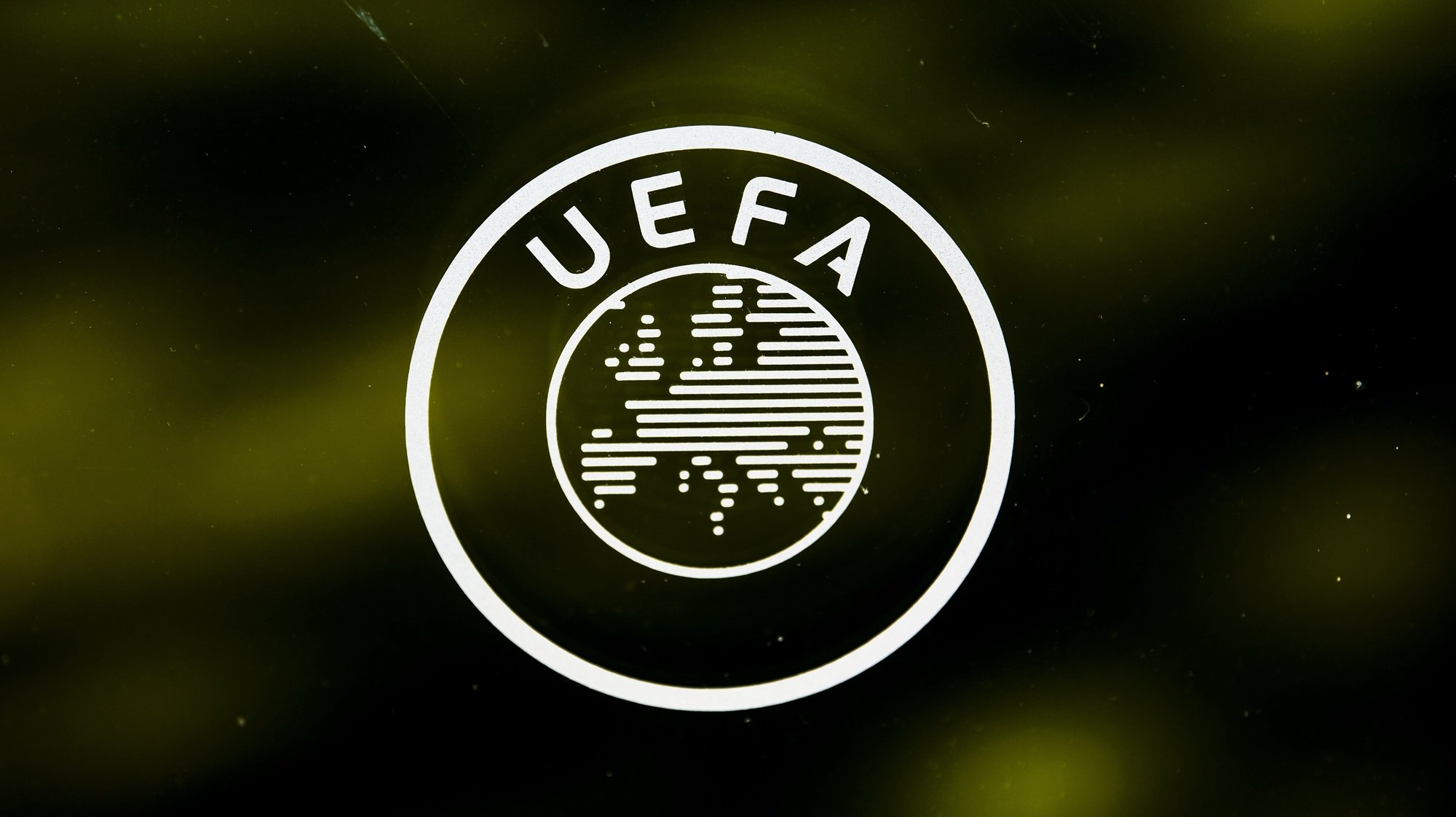 epa08389061 (FILE) - A UEFA logo is pictured through a window prior to the UEFA Europa League 2019/20 Round of 16 draw, at the UEFA Headquarters in Nyon, Switzerland, 28 February 2020 (re-issued on 28 April 2020). UEFA has given 25 May 2020 as a deadline date to European Leagues to decide wether to cancel or restart their seasons after the suspension amid COVID-19 coronavirus pandemic. UEFA's president Aleksander Ceferin explained that 'National Associations and/or Leagues should communicate to UEFA by 25 May 2020 the planned restart of their domestic competitions'. In case of cancelation 'UEFA would require the National Association to explain the special circumstances justifying such premature termination and to select clubs for the UEFA club competitions 2020/21 on the basis of sporting merit in the 2019/20 domestic competitions'.  EPA/JEAN-CHRISTOPHE BOTT *** Local Caption *** 55997733