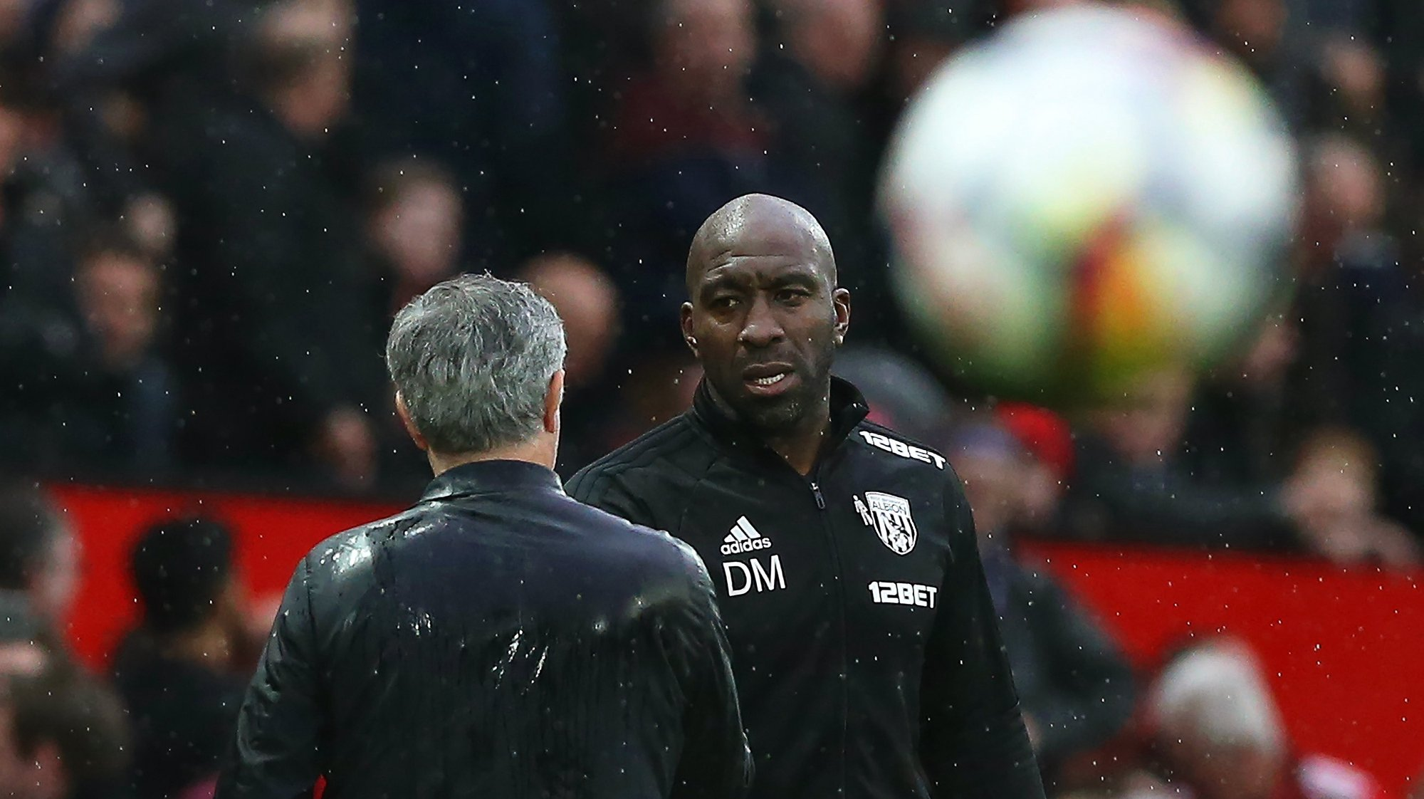 epa06671544 West Bromwich's manager Darren Moore (R) talks with Manchester United's manager Jose Mourinho (L) during the English Premier League soccer match between Manchester United and West Bromwich Albion at Old Trafford in Manchester, Britain, 15 April 2018.  EPA/NIGEL RODDIS EDITORIAL USE ONLY. No use with unauthorised audio, video, data, fixture lists, club/league logos 'live' services. Online in-match use limited to 75 images, no video emulation. No use in betting, games or single club/league/player publications.
