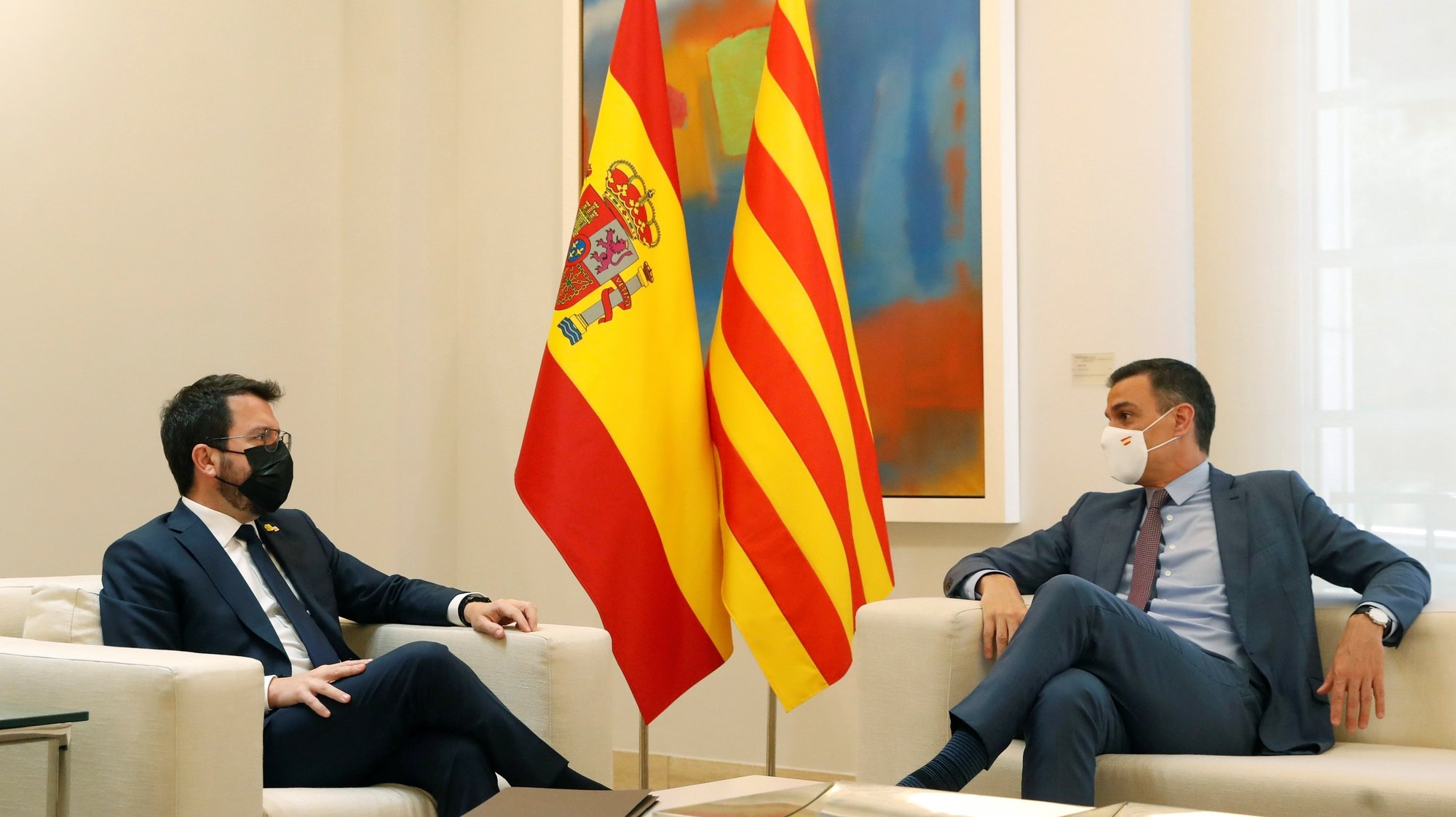 epa09311087 Spanish Prime Minister, Pedro Sanchez (R), receives Catalonia's regional president, Pere Aragones (L), during a meeting held at Moncloa Palace in Madrid, Spain, 29 June 2021.  EPA/Juan Carlos Hidalgo