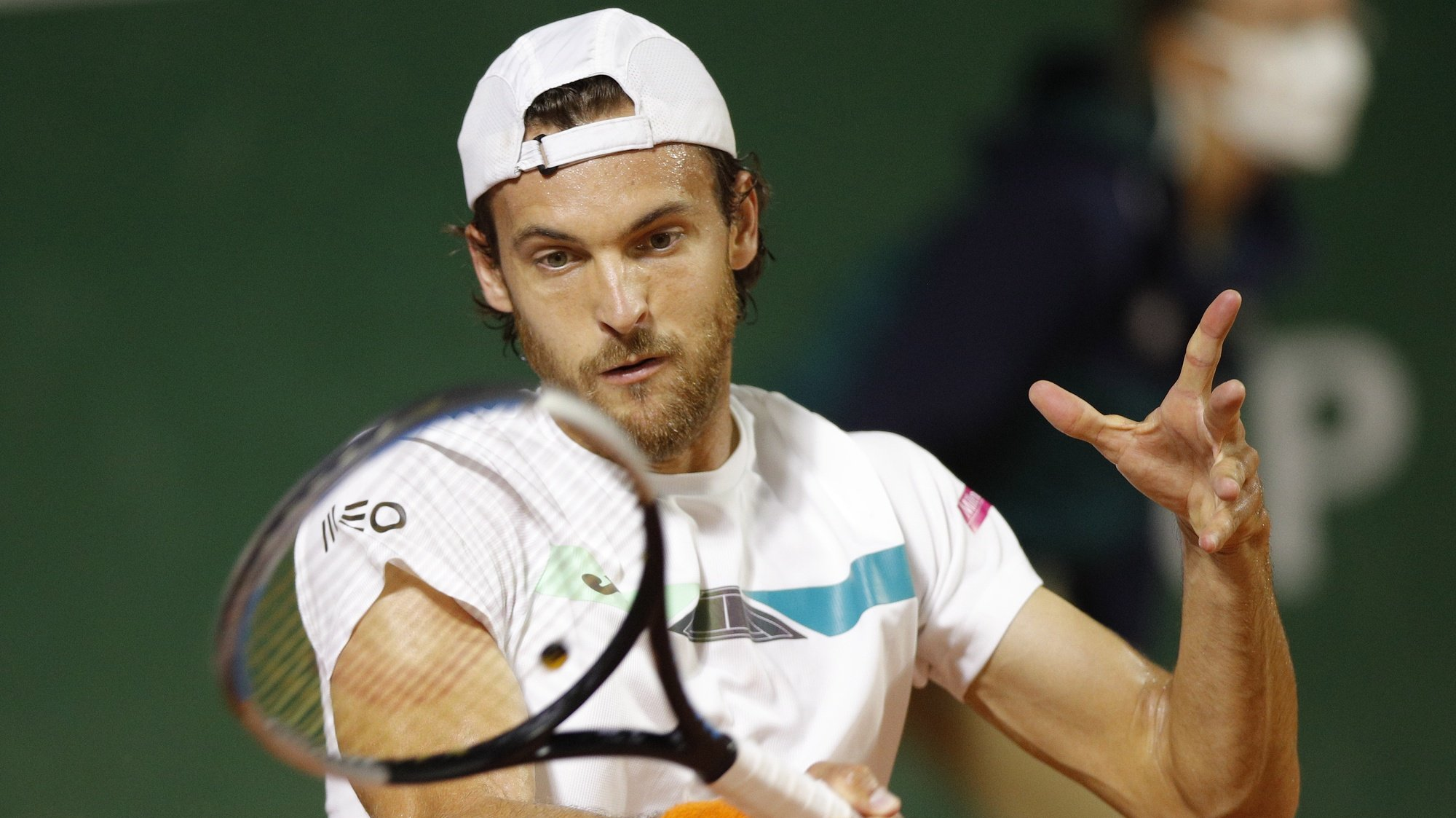 epa08706517 Joao Sousa of Portugal hits a forehand during his first round match against Andrej Martin of Slovakia at the French Open tennis tournament at Roland Garros in Paris, France, 29 September 2020.  EPA/YOAN VALAT