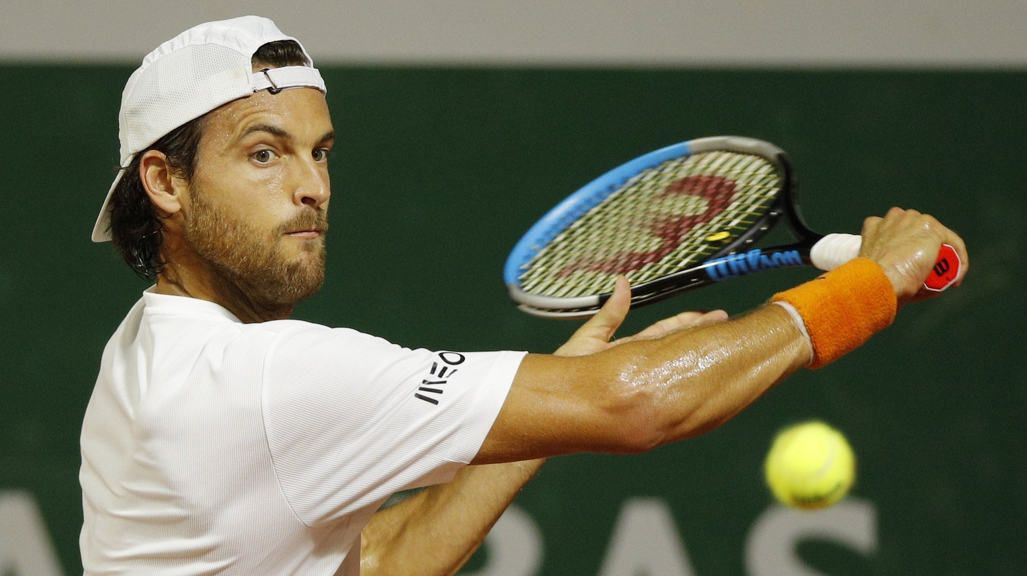 epa08706518 Joao Sousa of Portugal eyes the ball during his first round match against Andrej Martin of Slovakia at the French Open tennis tournament at Roland Garros in Paris, France, 29 September 2020.  EPA/YOAN VALAT
