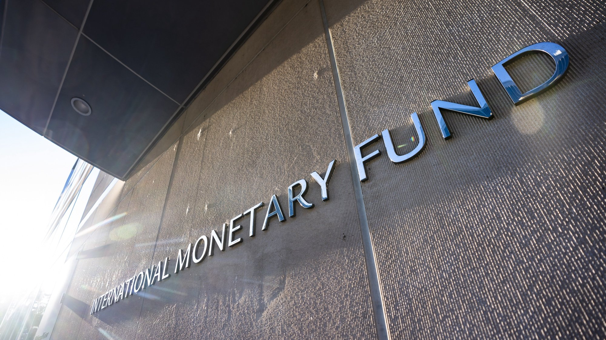epa08743975 A sign for the International Monetary Fund (IMF) outside its headquarters in Washington, DC, USA, 14 October 2020. The IMF World Bank Group 2020 annual fall meeting has gone virtual due to the Coronavirus pandemic.  EPA/JIM LO SCALZO