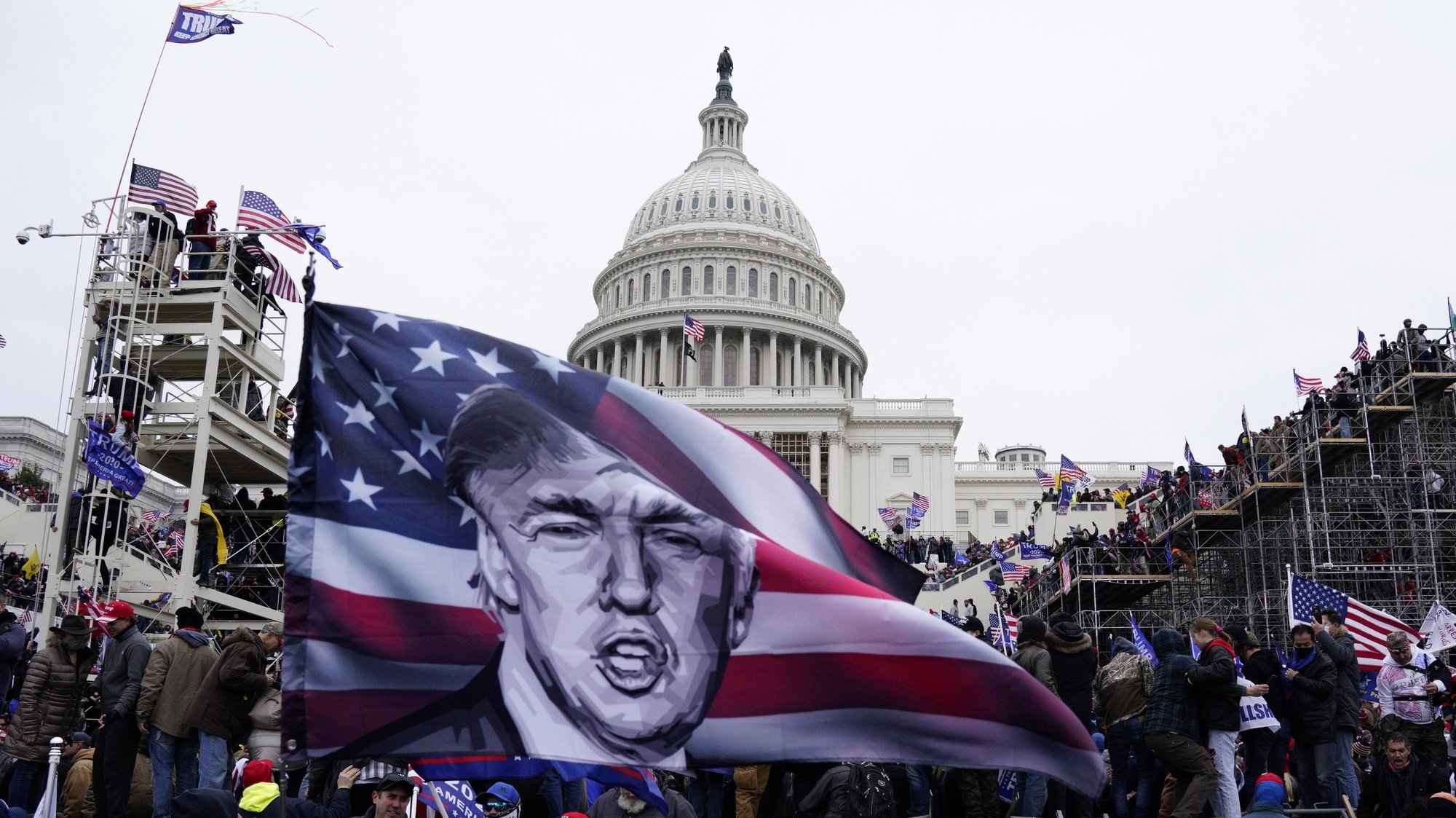 epaselect epa08923664 Pro-Trump protesters storm the grounds of the US Capitol, in Washington, DC, USA, 06 January 2021. Various groups of Trump supporters have broken into the US Capitol and rioted as Congress prepares to meet and certify the results of the 2020 US Presidential election.  EPA/WILL OLIVER