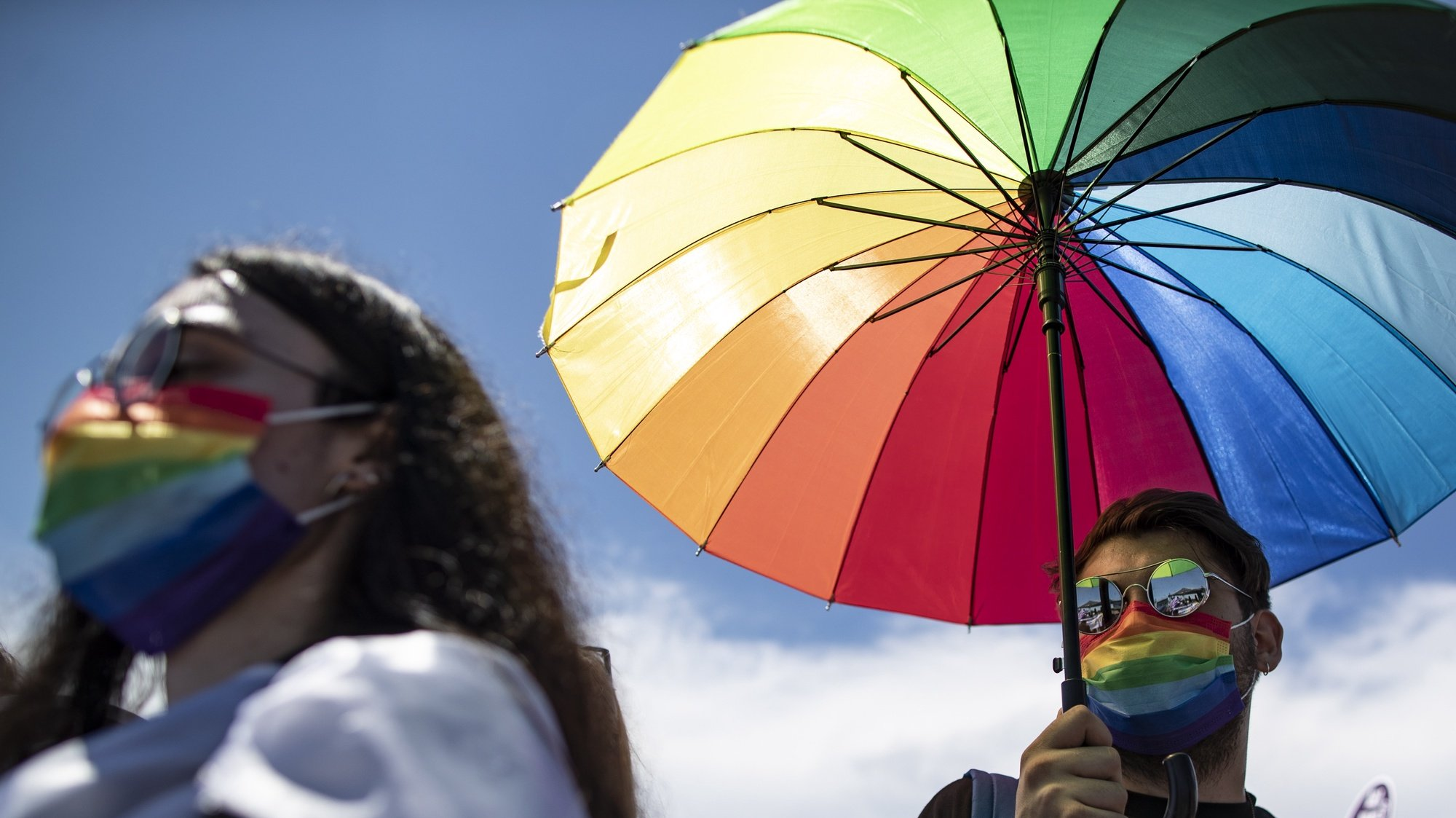 epa09285612 Members of the lesbian, gay, bisexual, transgender and queer (LGBTQ) community hold an umbrella with LGBTQI+ rainbow flag during a rally against Turkey's withdrawal from Istanbul Convention in Istanbul, Turkey, 19 June 2021. Turkish President Recep Tayyip Erdogan pulled Turkey out of the Istanbul Convention, which is an international accord designed to protect women, which was started by the Council of Europe in 2011 for the Prevention of Violence against Women and Domestic Violence, and is signed by 45 European countries as well as the EU as an organization.  EPA/ERDEM SAHIN